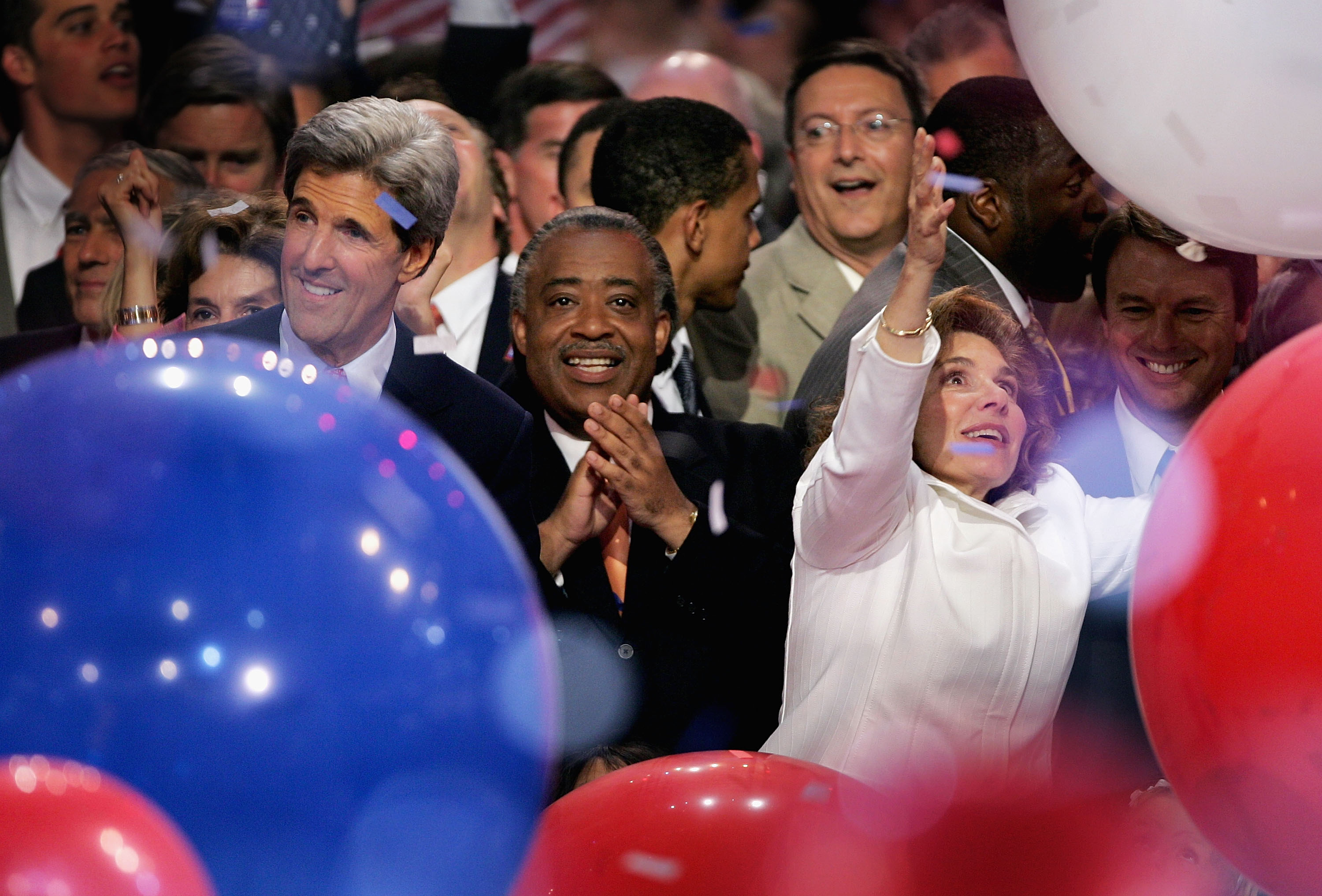 Senator John Kerry, the Reverend Al Sharpton, and Teresa Heinz Kerry celebrate Kerry's nomination for Democratic Presidential candidate onstage during the Democratic National Convention in Boston on July 29, 2004.