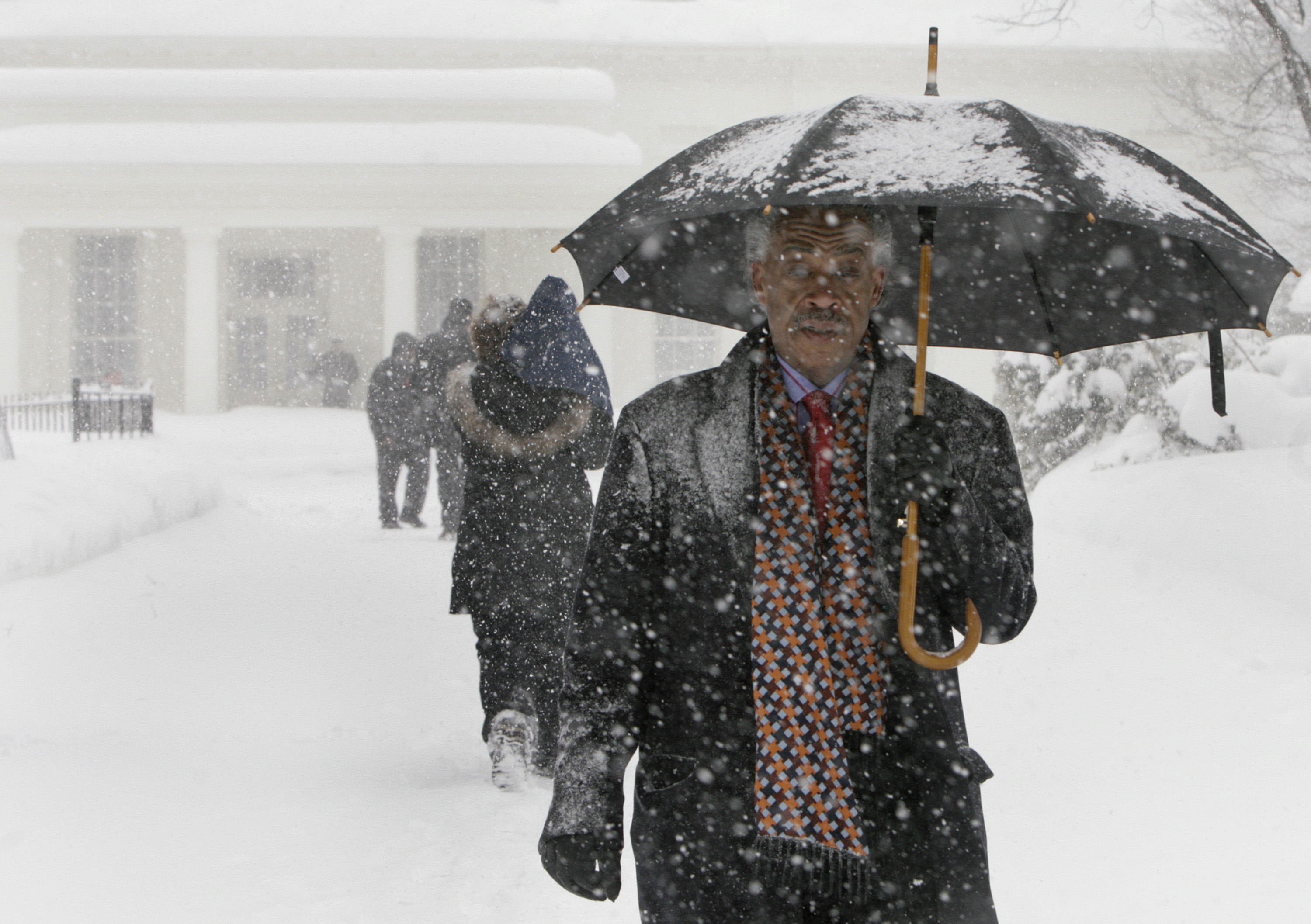The Rev. Al Sharpton (C), president and founder of the National Action Network, departs the White House following a meeting with President Barack Obama in Washington on Feb. 10, 2010.