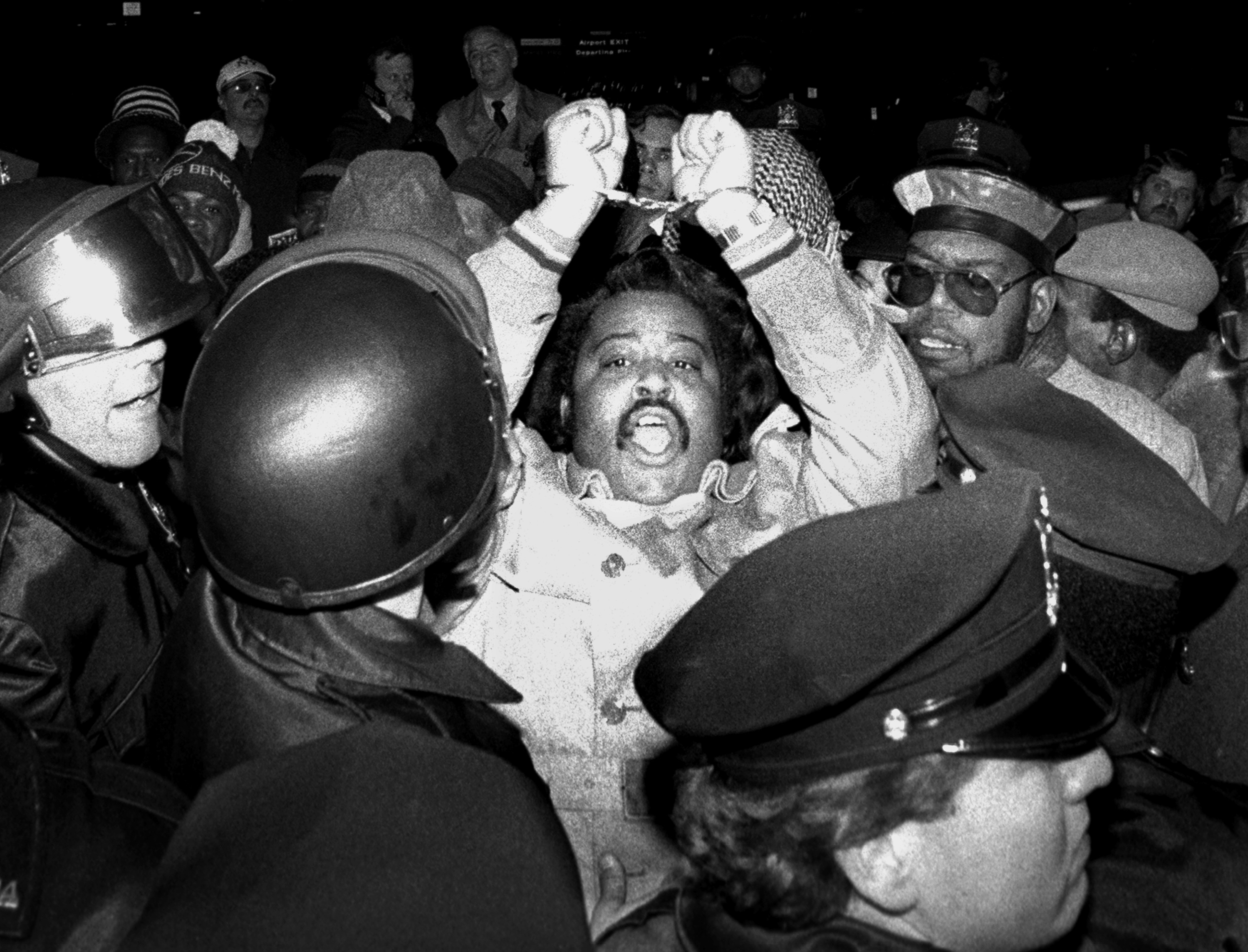 The Rev. Al Sharpton is arrested during an anti-racism demonstration at La Guardia Airport in New York City on Jan. 27, 1987.