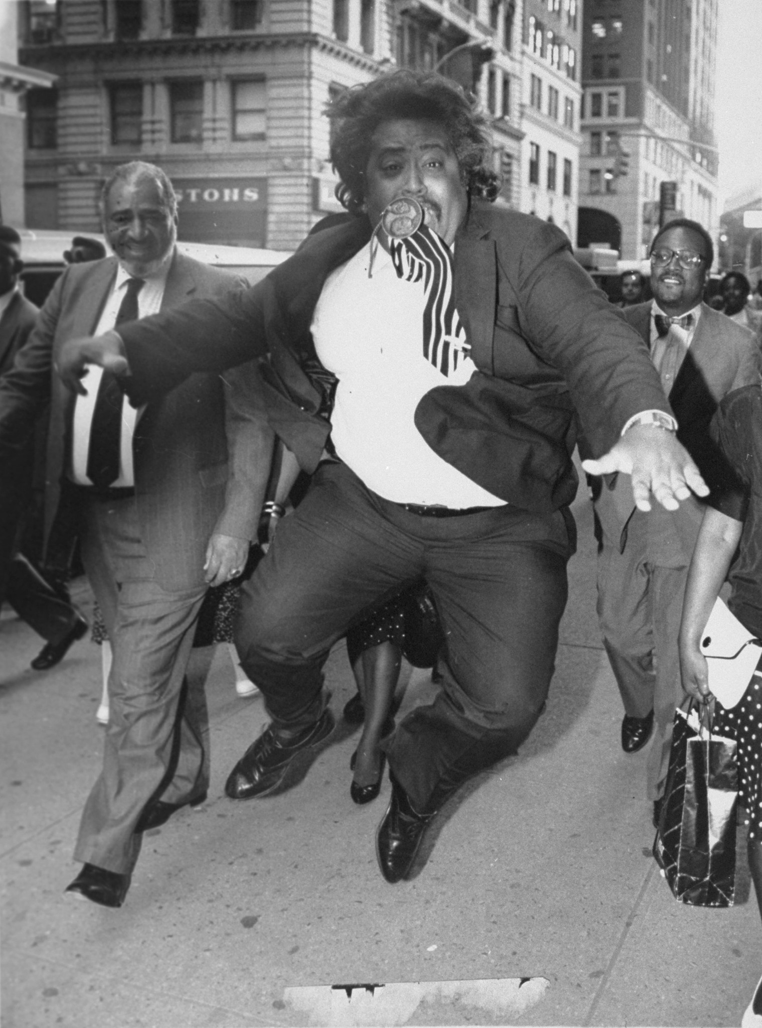 The Rev. Al Sharpton celebrates sentencing of Joey Fama and Keith Mondello for the murder of Yusef Hawkins outside a Brooklyn Court in New York City, June 11, 1990.