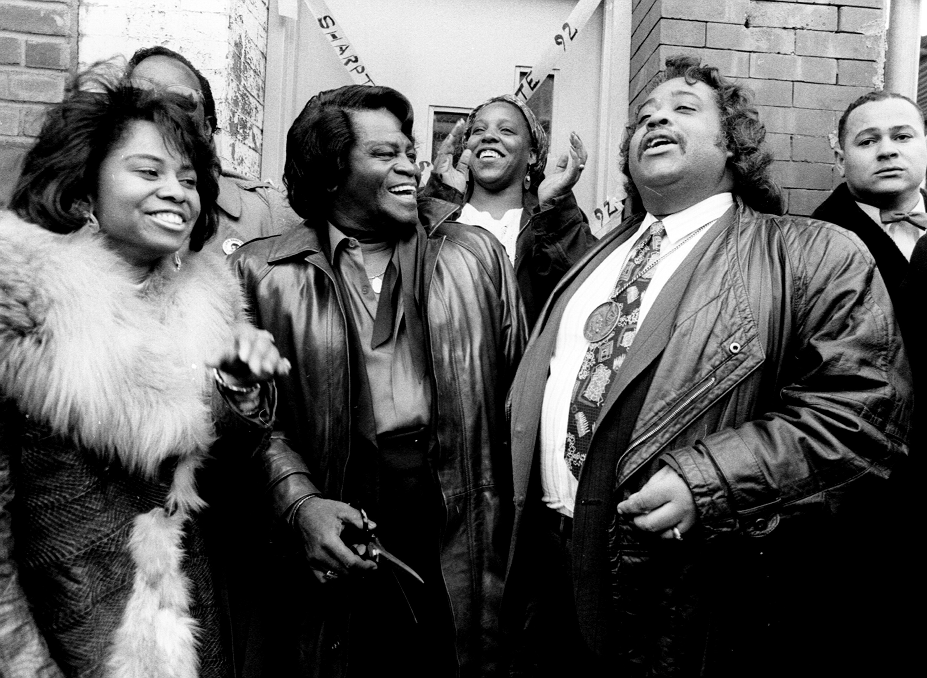From left: Diana Brown, daughter of James Brown, James Brown and Al Sharpton at ribbon cutting ceremony for Sharpton's senate race in New York City on Feb. 26, 1992.