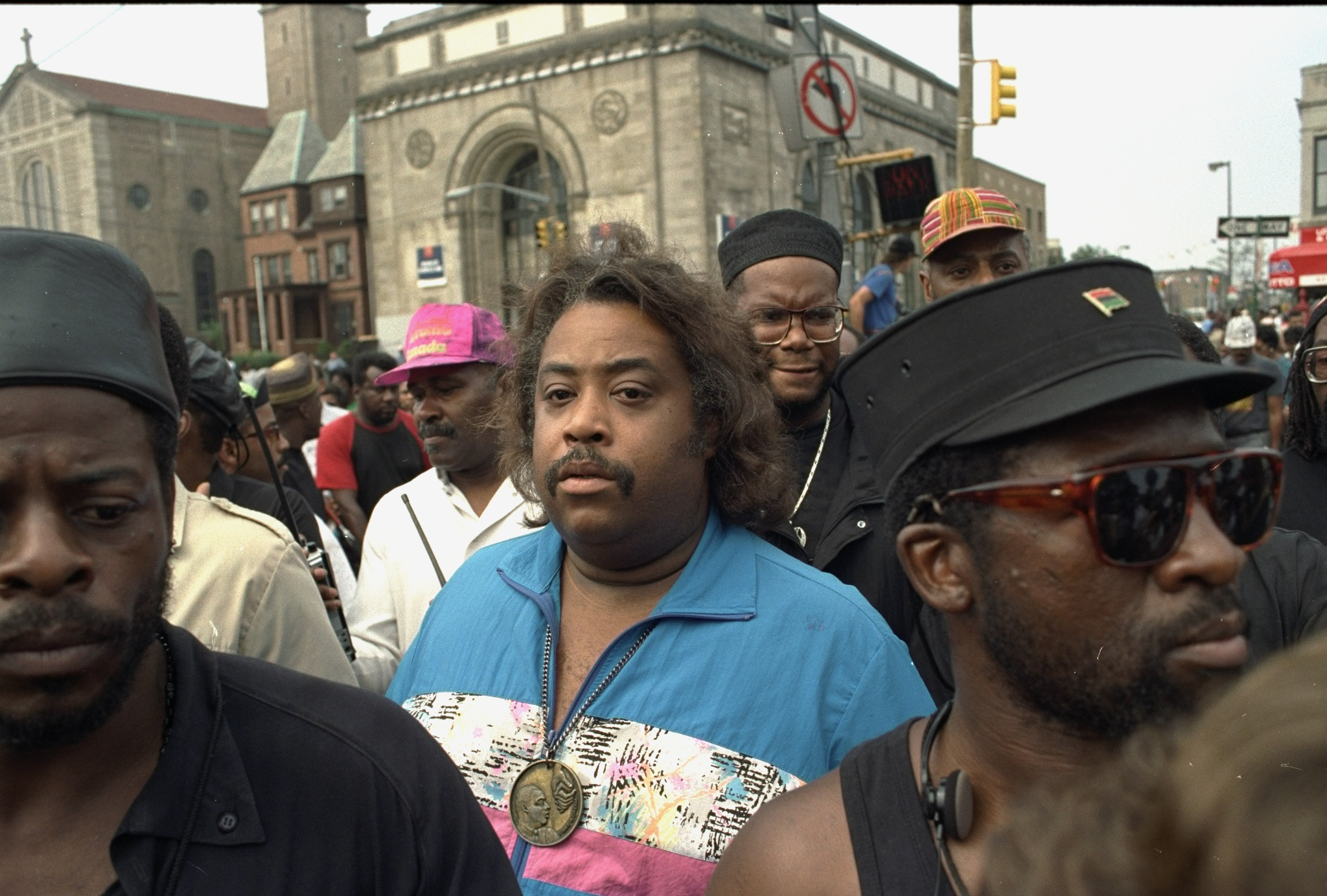 The Rev. Al Sharpton joins black demonstrators marching in protest after days of rioting in Crown Heights, Brooklyn after two black 7-year-olds, Gavin and Angela Cato, were hit by a car driven by a member of the Hasidic Jewish community, New York City, 2000.