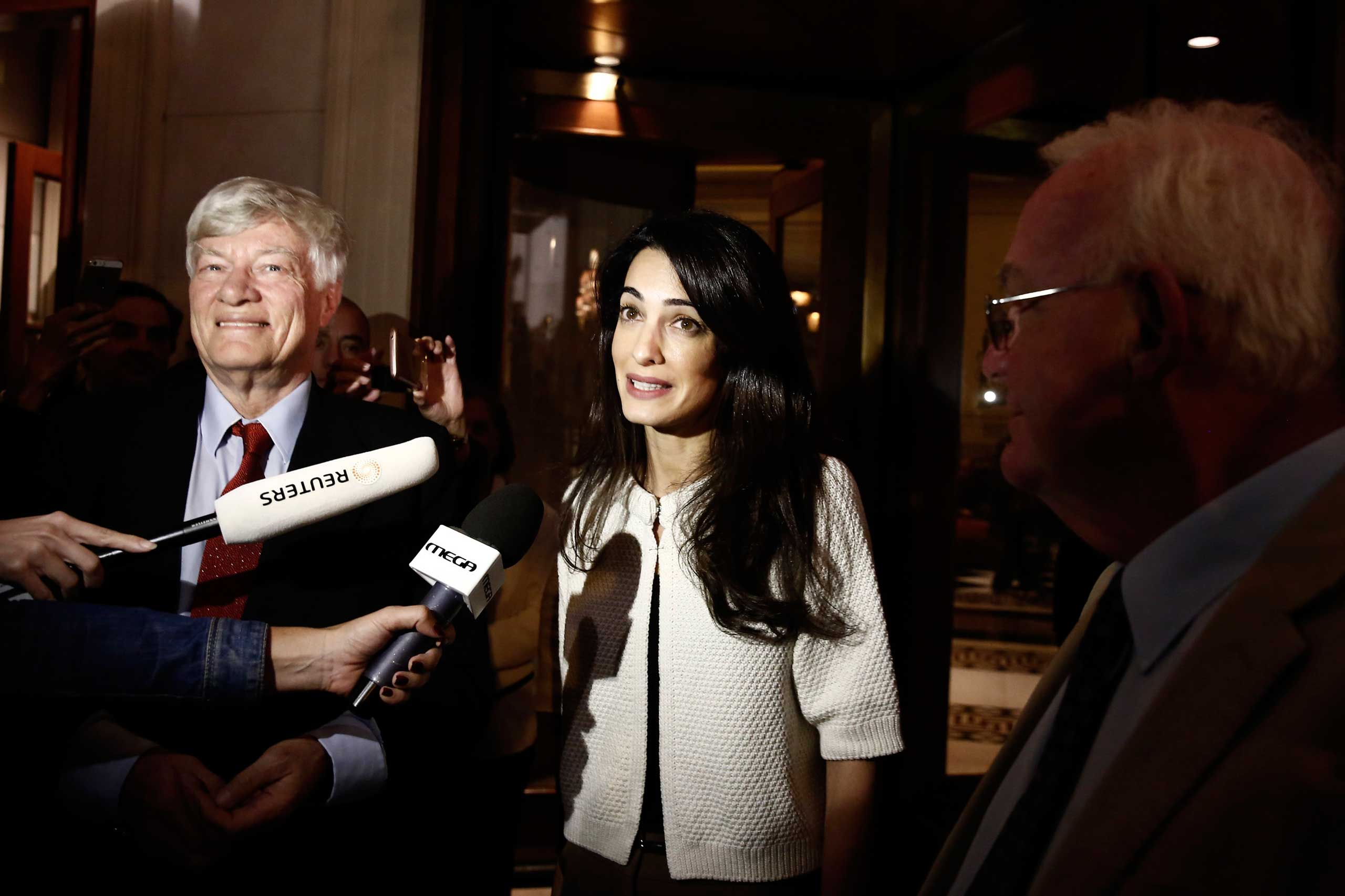 Lawyer Amal Clooney speaks to media in Athens on Oct. 13, 2014