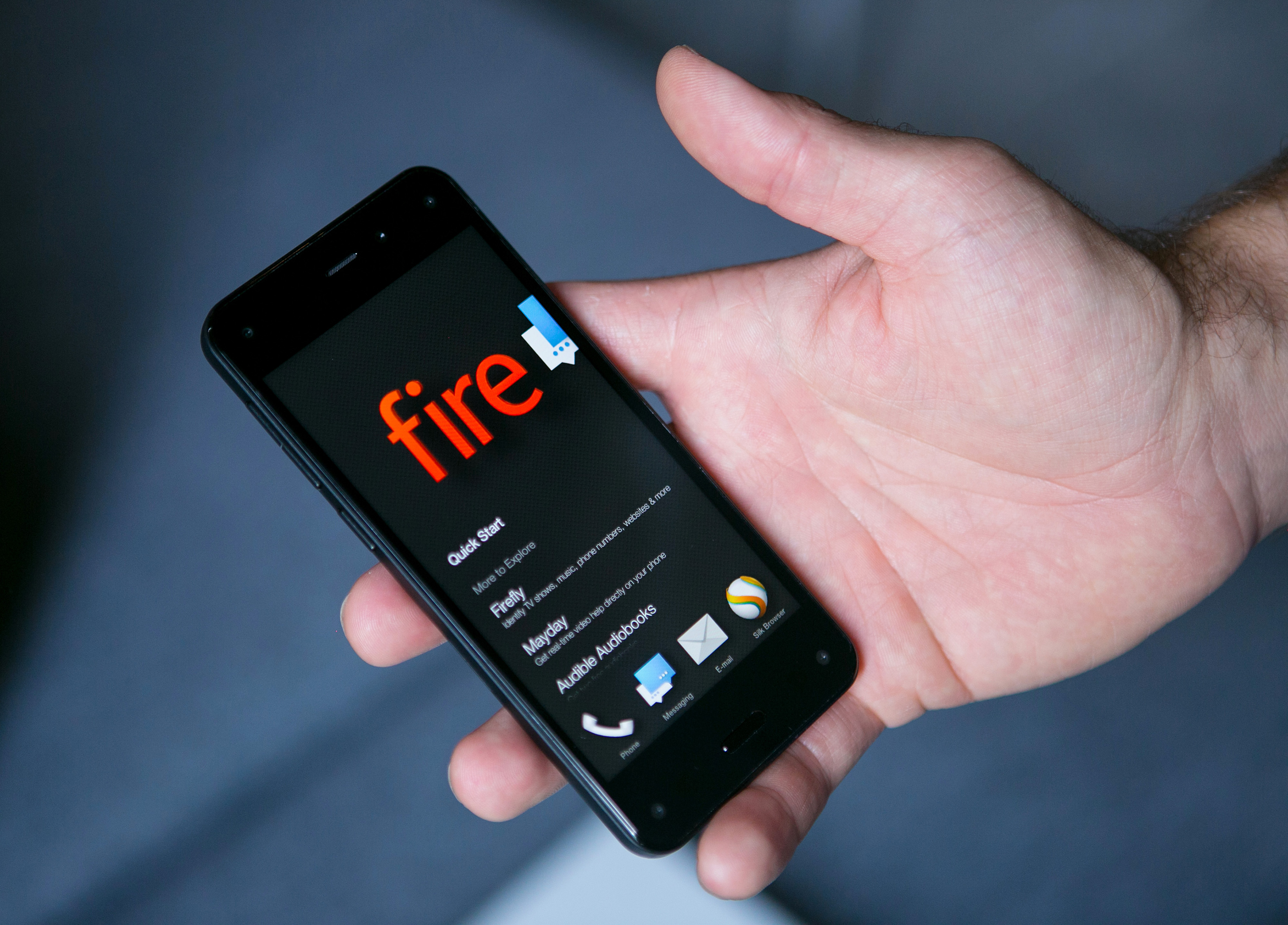 A man holds the new Fire smartphone by Amazon.com Inc. during demonstration at a a news conference in Berlin, Germany, on Monday, Sept. 8, 2014.