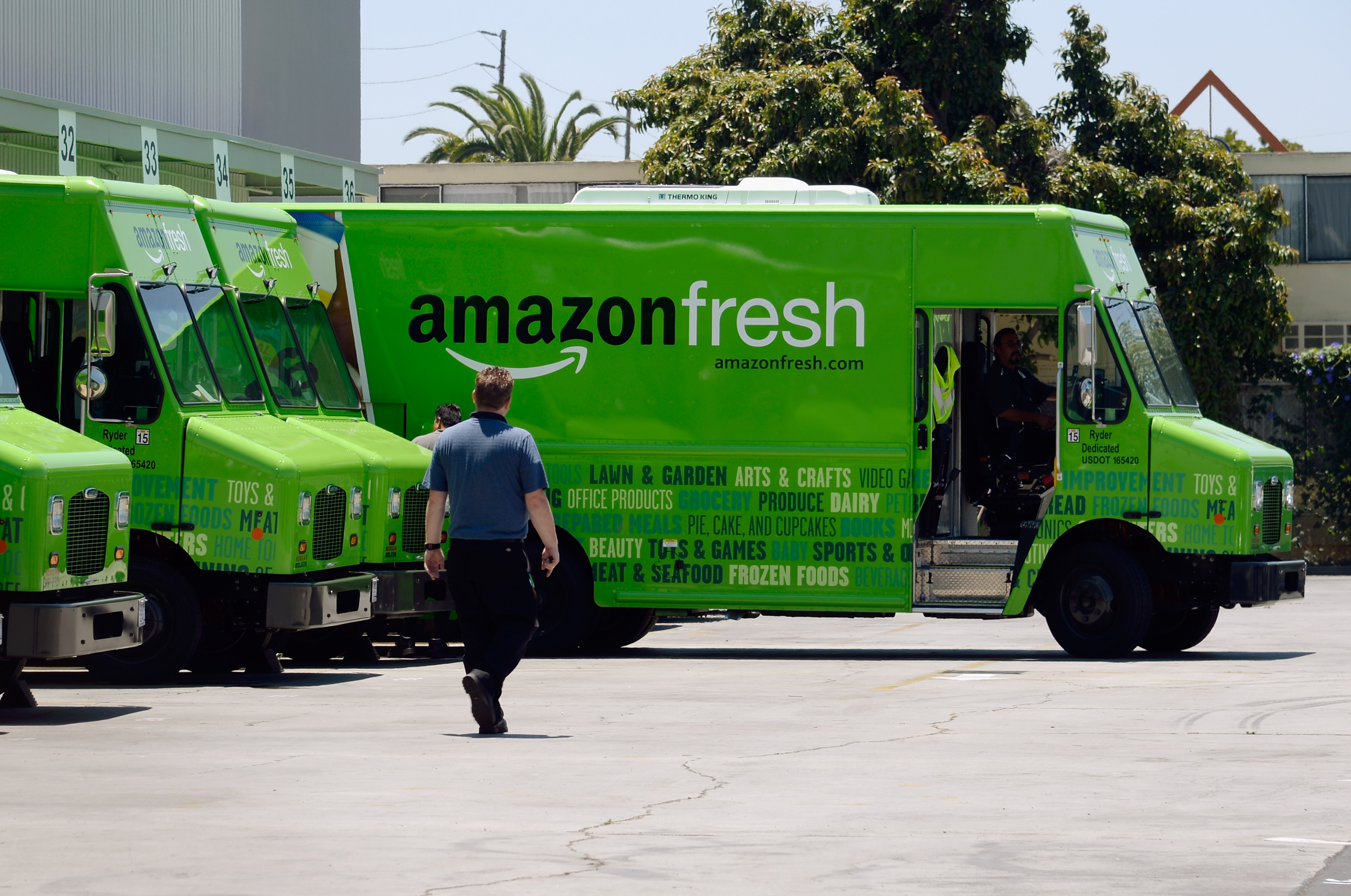 An Amazon Fresh truck arrives at a warehouse on June 27, 2013 in Inglewood, California.
