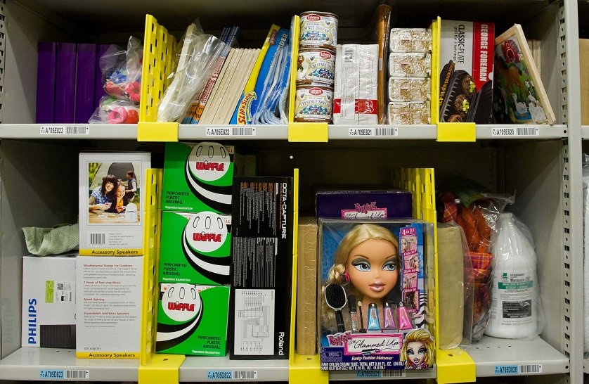 Merchandise sits on shelves before shipment at the Amazon.com Inc. distribution center in Phoenix, Arizona, Nov. 26, 2012.