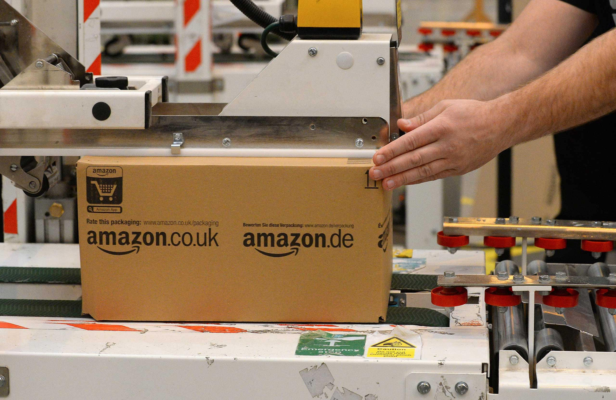 An employee packs orders in the Fulfilment Centre for online retail giant Amazon in Peterborough, central England, on November 28, 2013, ahead of Cyber Monday on December 2nd, expected to be one of the busiest online shopping days of the year.