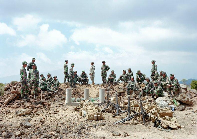 Indonesian Marines with U.S. Army interpreter, Pohakuloa training area, Hawaii, 2012.