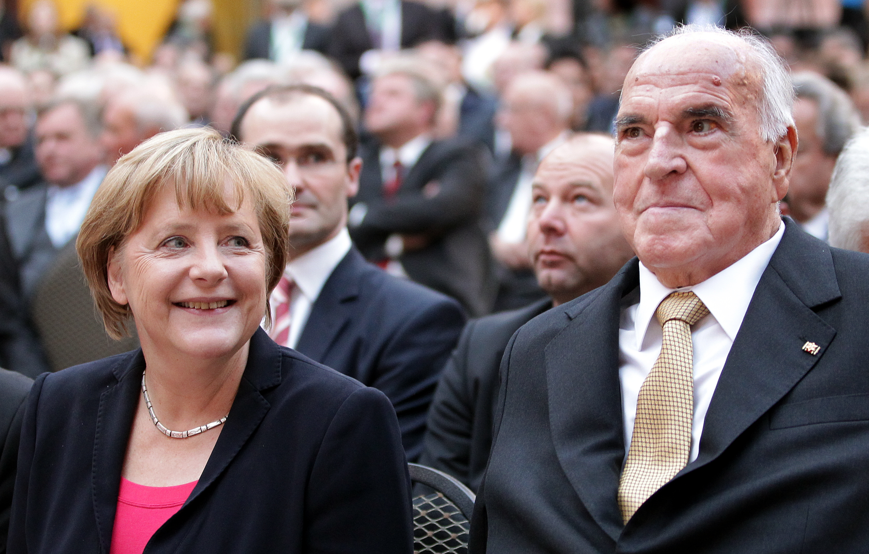Former German Chancellor Helmut Kohl and German Chancellor Angela Merkel sit in the first row at the German Historical Museum in Berlin on Sept. 27, 2012.