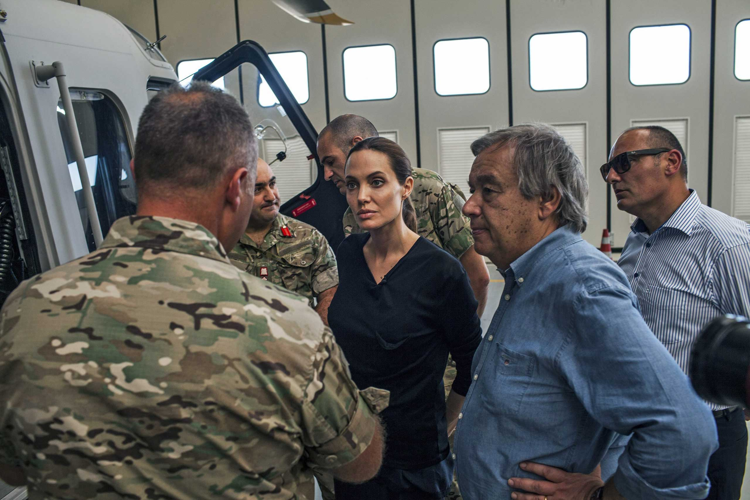 Angelina Jolie. in her role as the United Nations High Commissioner for Refugees Special Envoy, listening to Maltese military officers discussing rescue at sea operations for refugees at a military base in Valetta, Malta, Sept. 14, 2014.