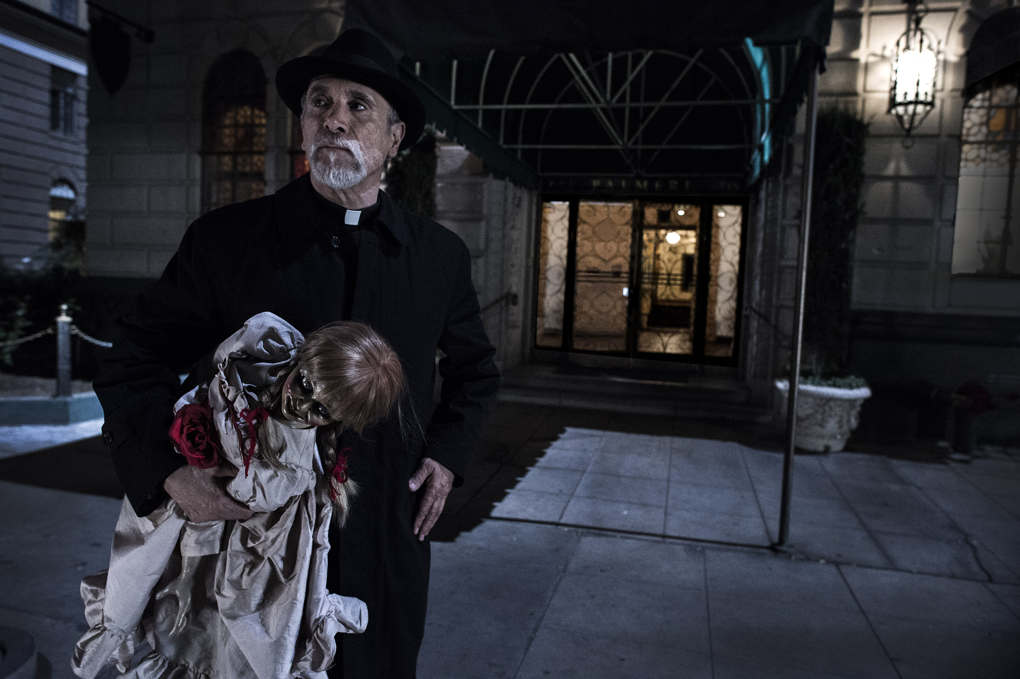 Tony Amendola as Father Perez with the Annabelle doll in Annabelle.