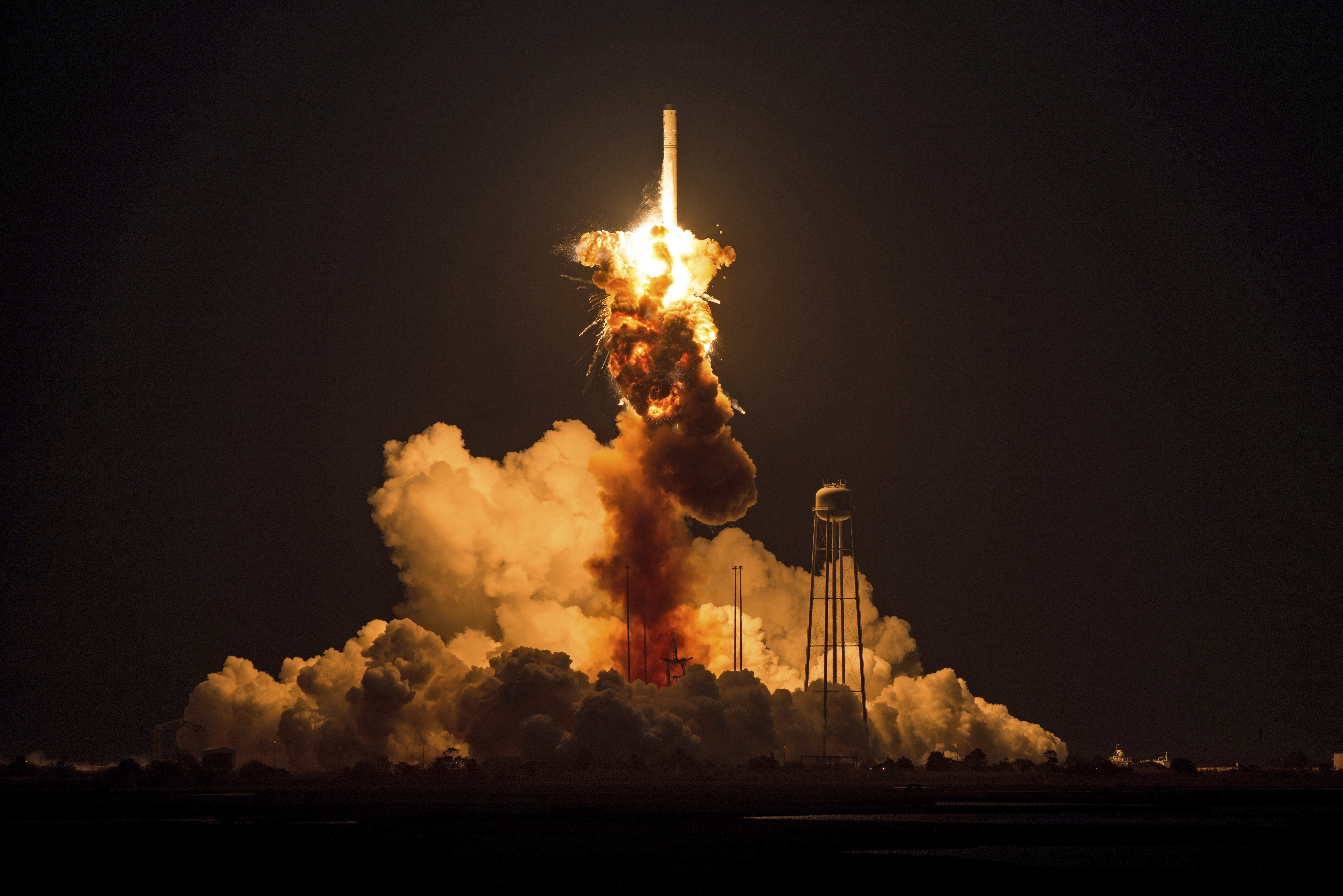 This image provided by NASA shows the Orbital Sciences Corporation Antares rocket, with the Cygnus spacecraft onboard suffers a catastrophic anomaly moments after launch from the Mid-Atlantic Regional Spaceport Pad 0A, Tuesday, Oct. 28, 2014, at NASA's Wallops Flight Facility in Virginia.