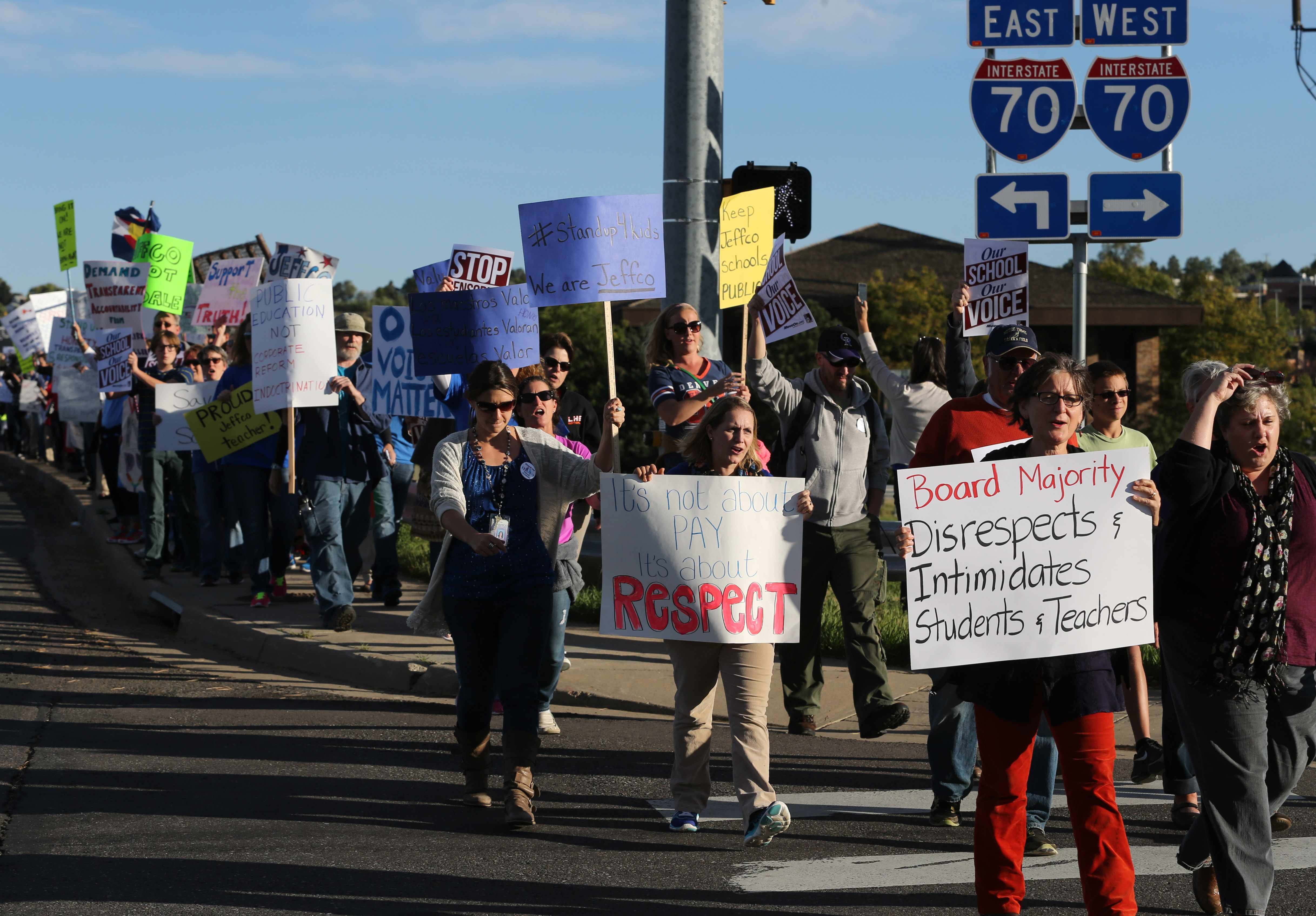 Teachers, students and supporters march near the location of an ongoing Jefferson County School Board meeting, in Golden, Colo., Thursday, Oct. 2, 2014.
