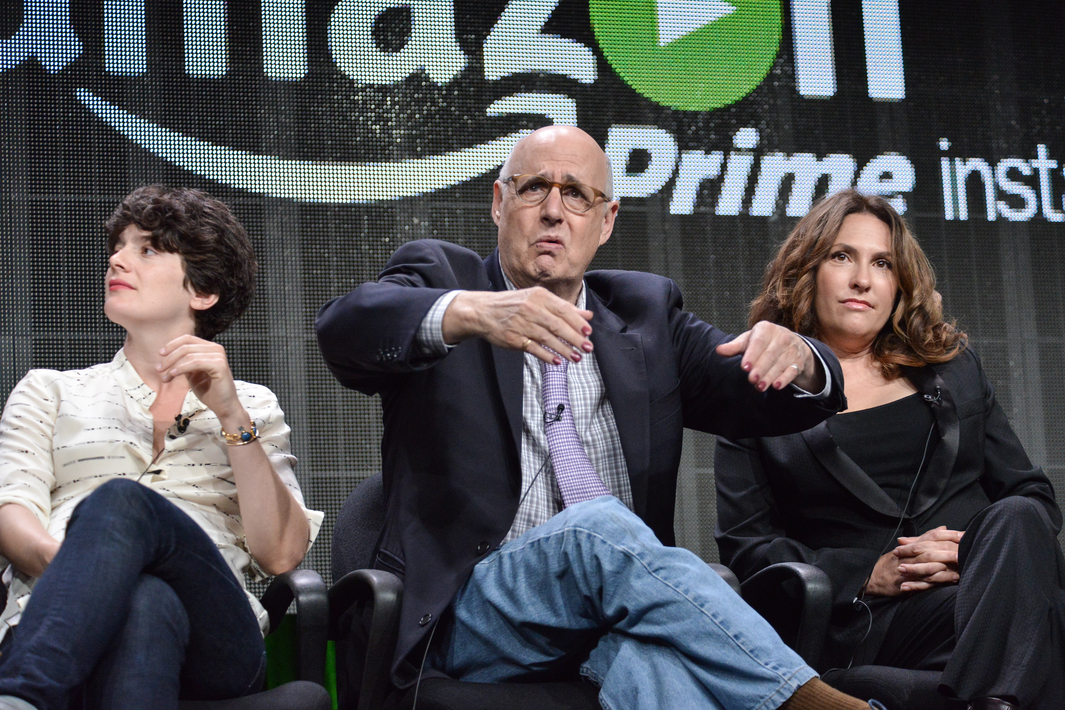 From left, Gaby Hoffmann, Jeffrey Tambor, and Jill Soloway speak onstage during the  Transparent  panel at the Amazon 2014 Summer TCA on Saturday, July 12, 2014, in Beverly Hills, Calif. (Photo by Richard Shotwell/Invision/AP)