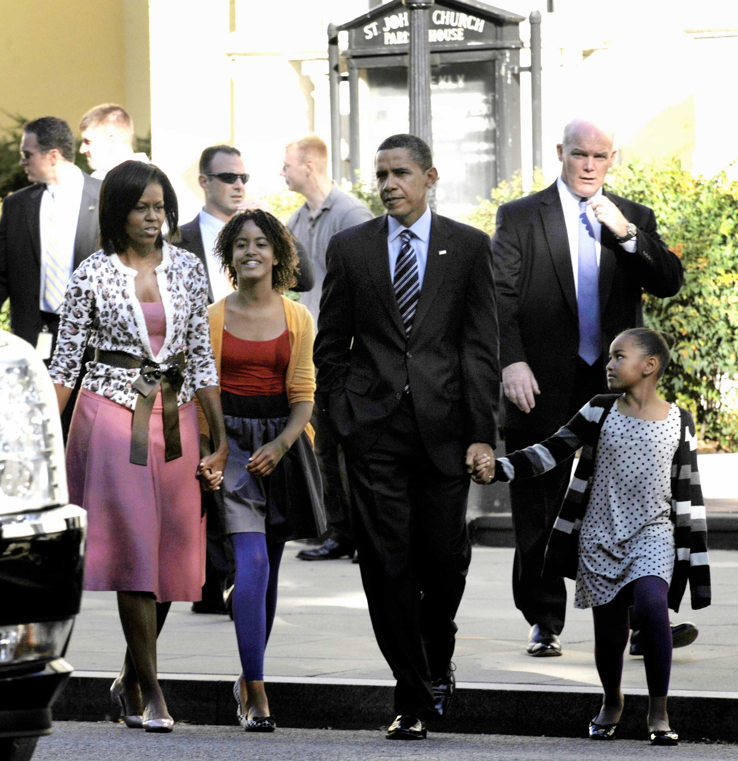 Clancy is seen speaking over the radio into his palm mic as he glances in the camera's direction as  President Barack Obama and his family walk back to the White House after attending St. John's Episcopal Church in Washington D.C. on Oct. 11, 2009.