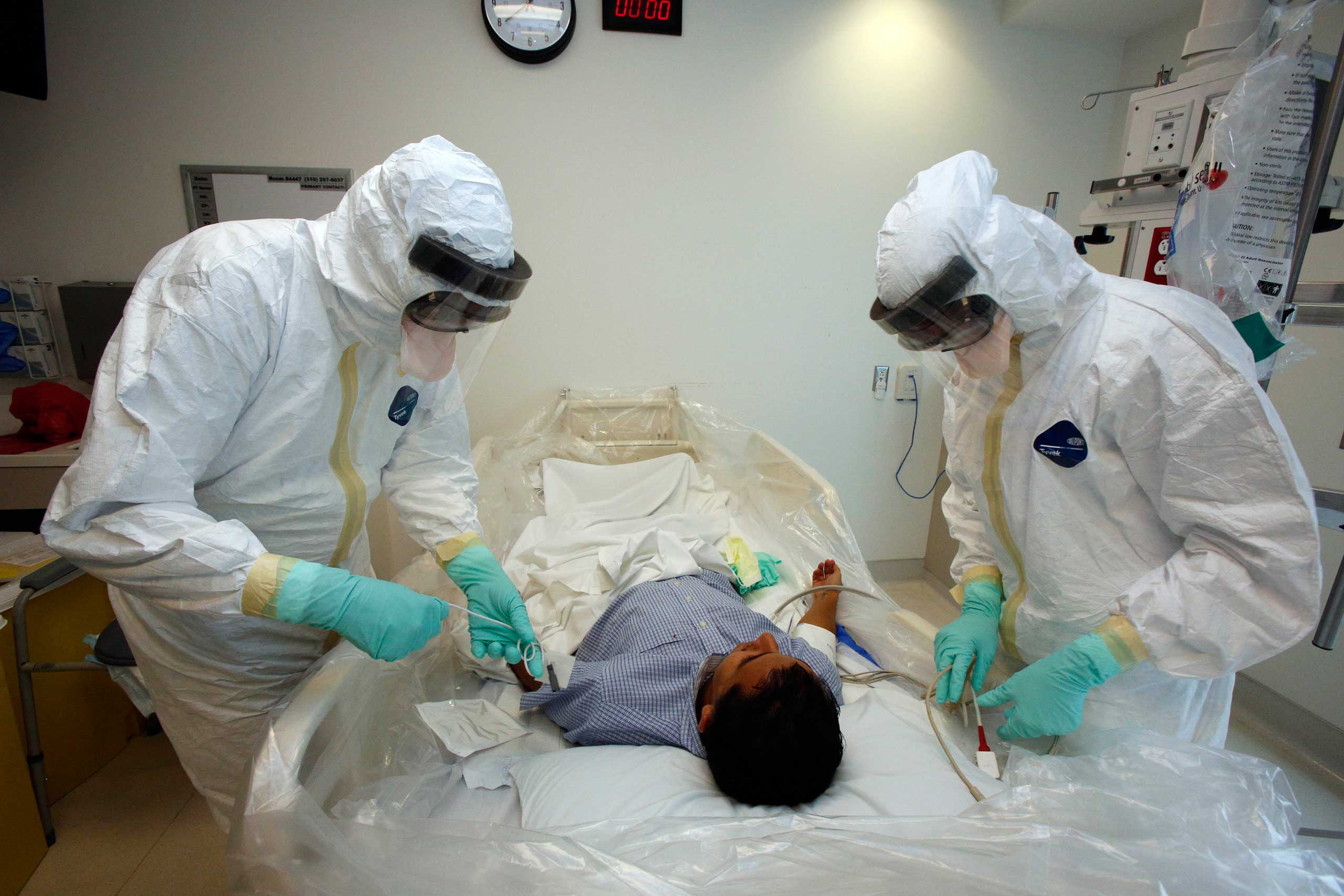 Doctors and staff participate in a preparadness exercise on diagnosing and treating patients with Ebola virus symptoms, at the Ronald Reagan UCLA Medical Center in Los Angeles.