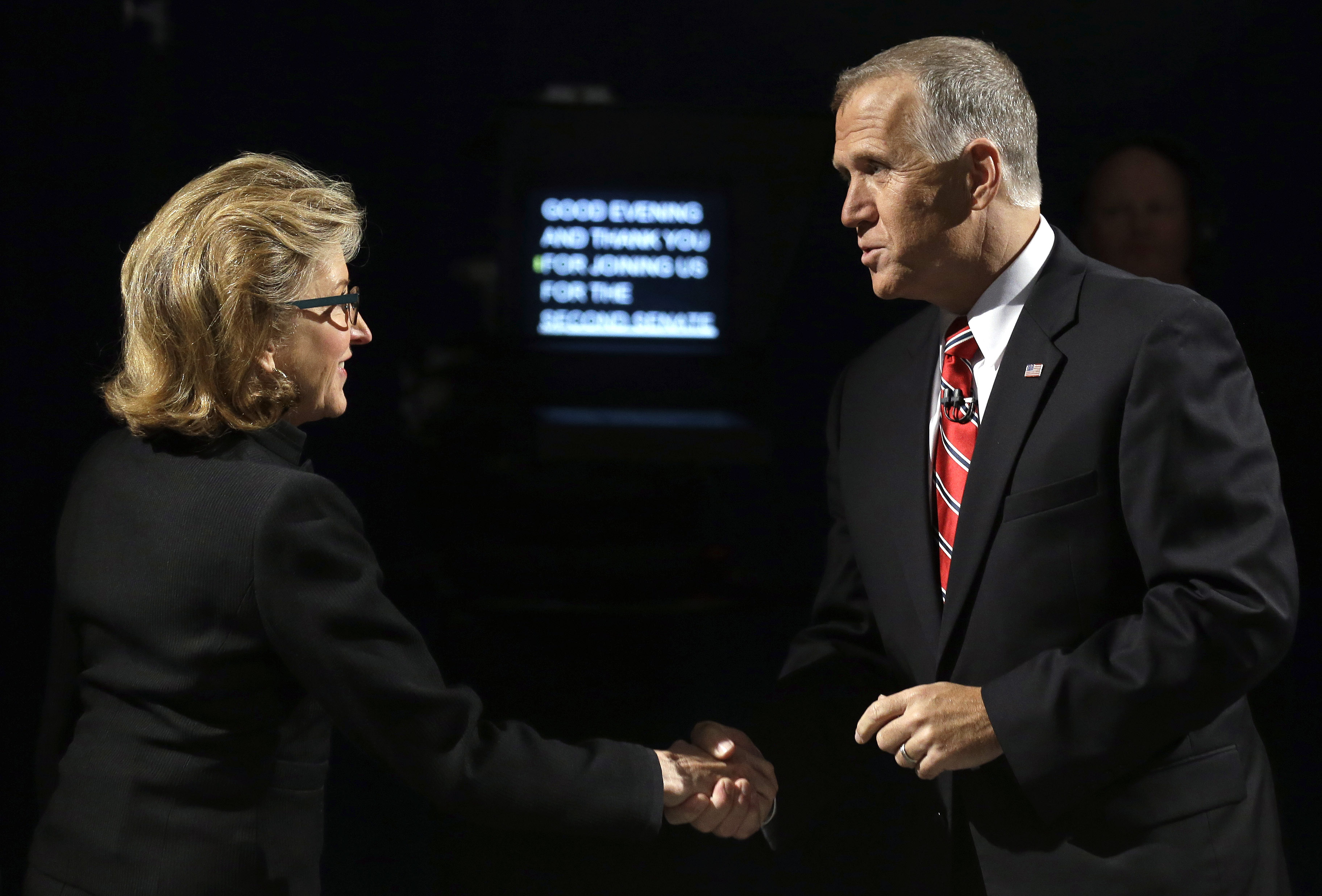Sen. Kay Hagan, left, D-N.C., and North Carolina Republican Senate candidate Thom Tillis greet prior to a live televised debate at UNC-TV studios in Research Triangle Park, N.C.