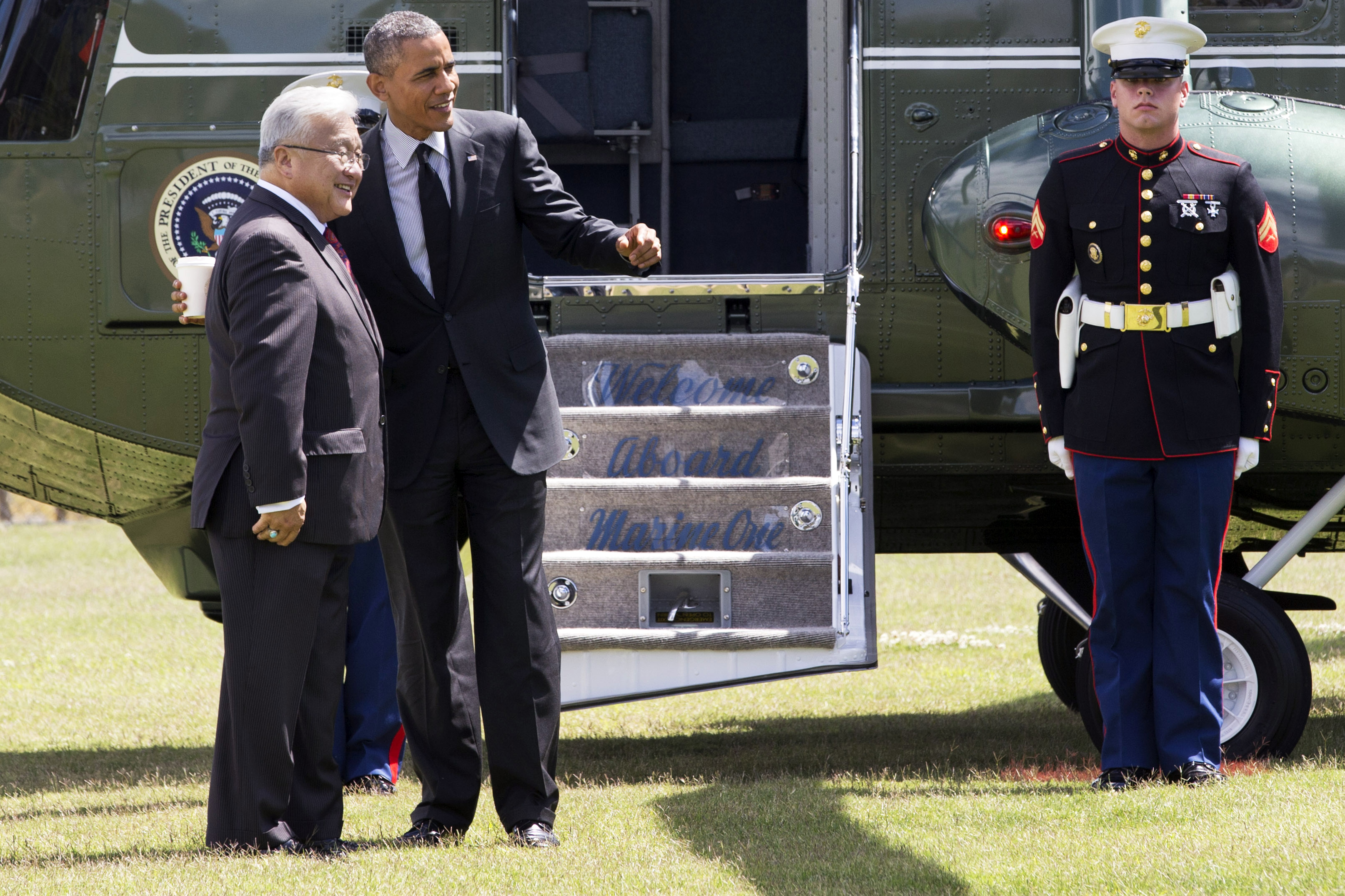 President Barack Obama is greeted by Rep. Mike Honda, D-Calif., as the president arrives in Los Altos Hills, Calif., where he will attend a fundraising event Wednesday, July 23, 2014, during his three-day West Coast trip to Seattle, San Francisco and Los Angeles.