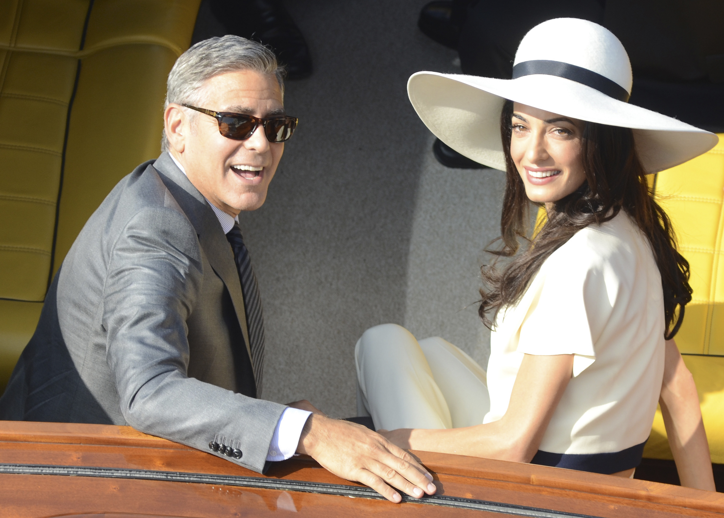 George Clooney and his wife Amal Alamuddin leave the city hall after their civil marriage ceremony in Venice, Italy,