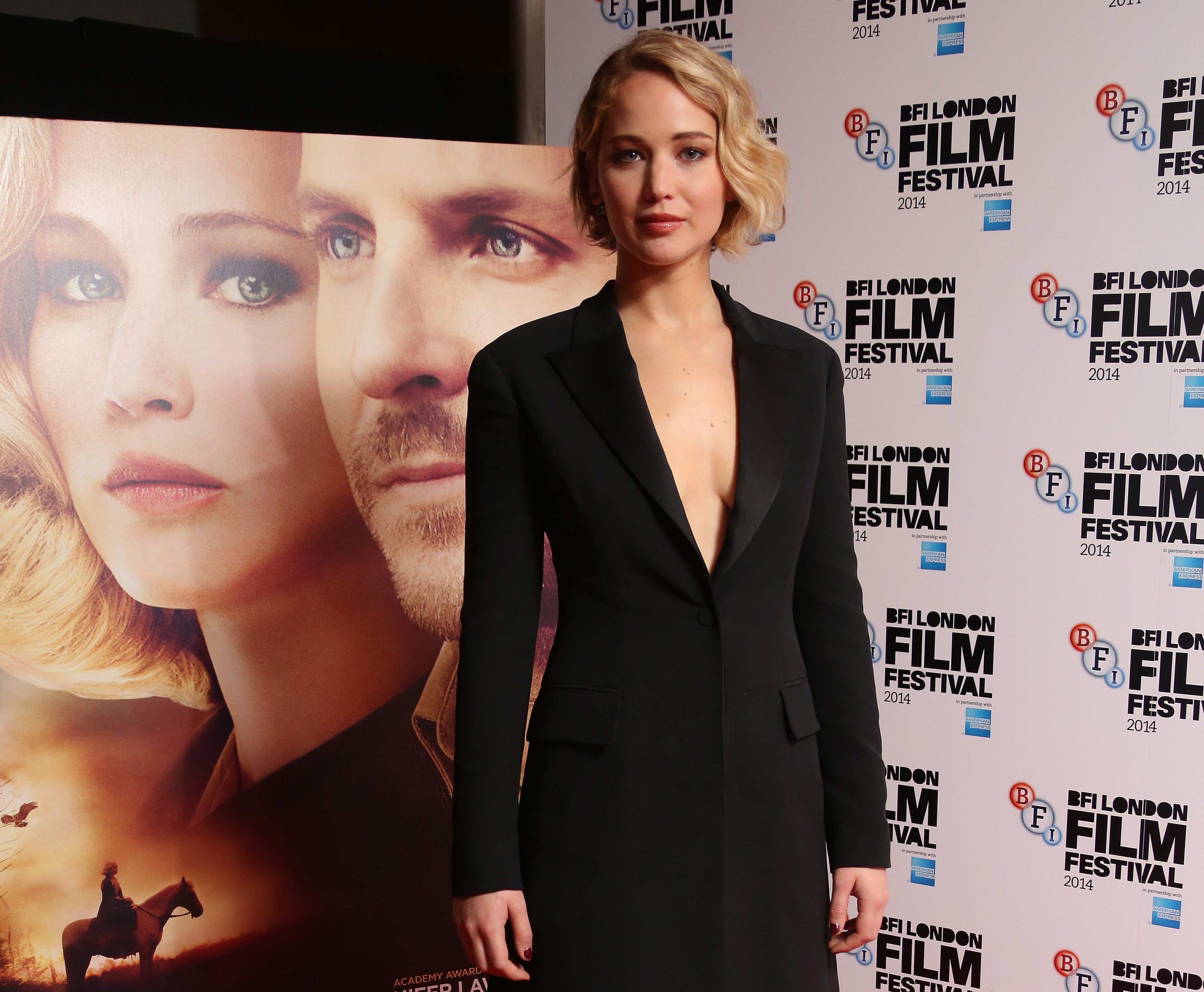 Actress Jennifer Lawrence poses for photographs during the photo call for the film Serena, as part of London Film Festival, at the Vue cinema in central London, Monday, Oct. 13, 2014. (Photo by Joel Ryan/Invision/AP)