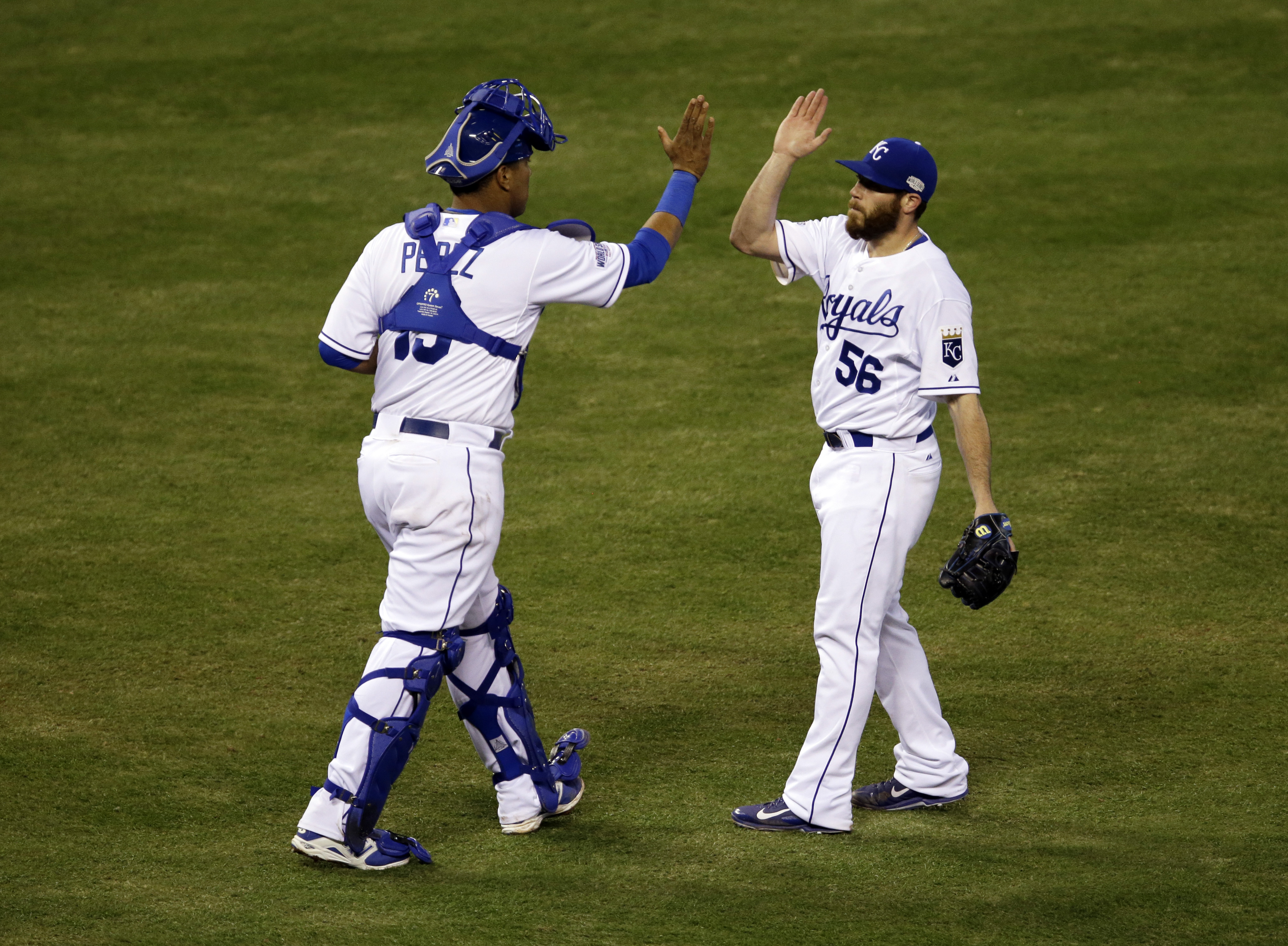 Kansas City Royals catcher Salvador Perez and Greg Holland celebrate after Game 2 of the World Series in Kansas City on Oct. 22, 2014