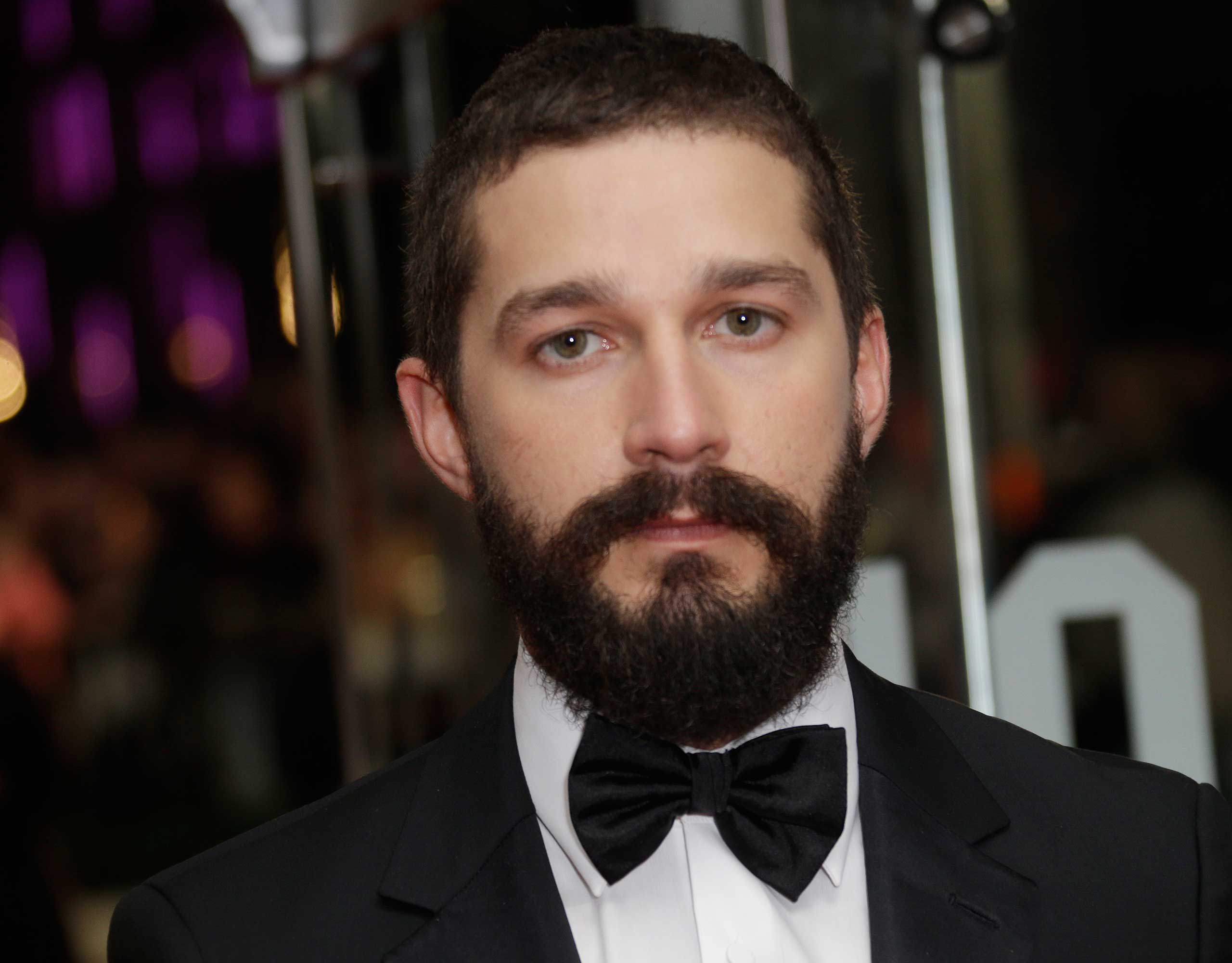 Shia LaBeouf poses for photographers at a film premiere in London, Oct. 19, 2014.