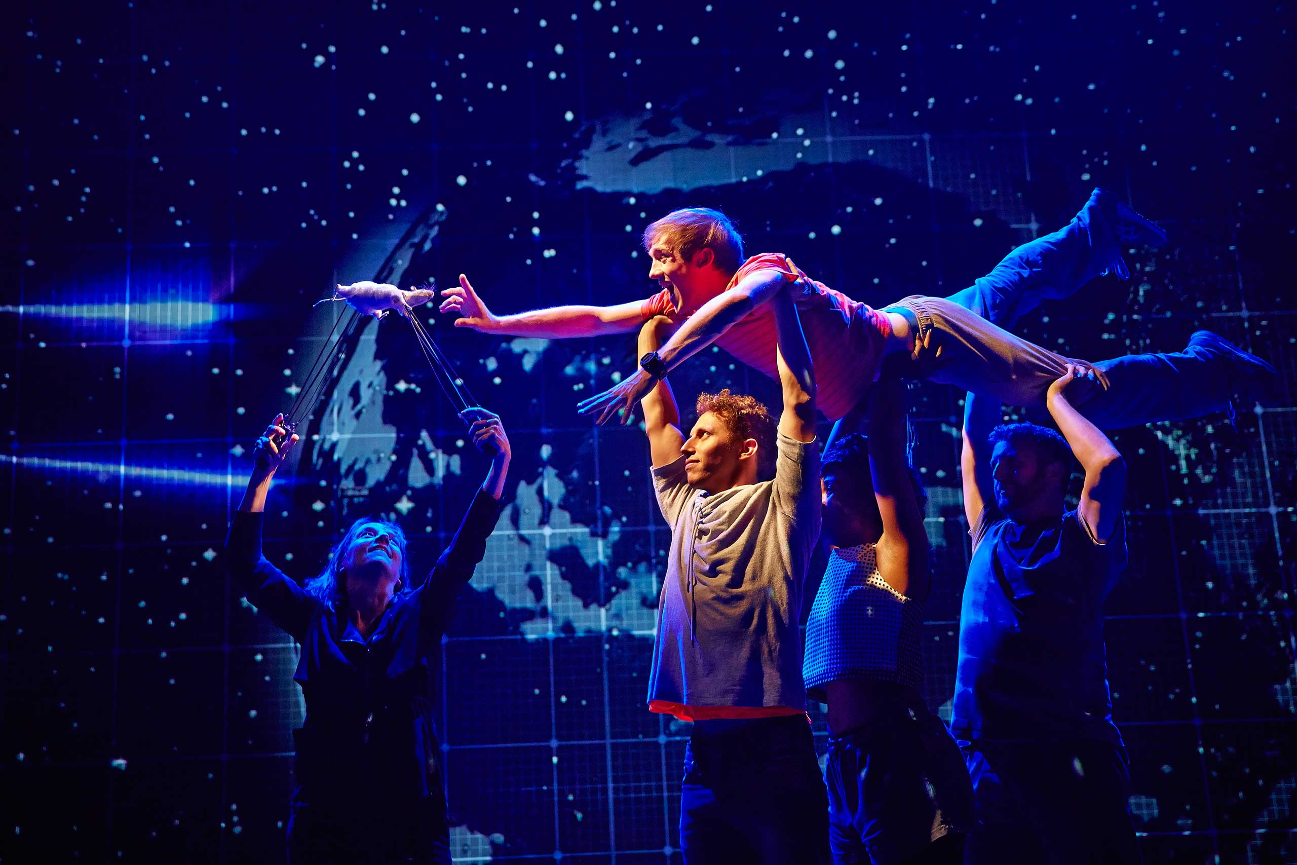 "This image released by Boneau/Bryan-Brown shows the cast during a performance of ""The Curious Incident of the Dog in the Night-Time,  in London."