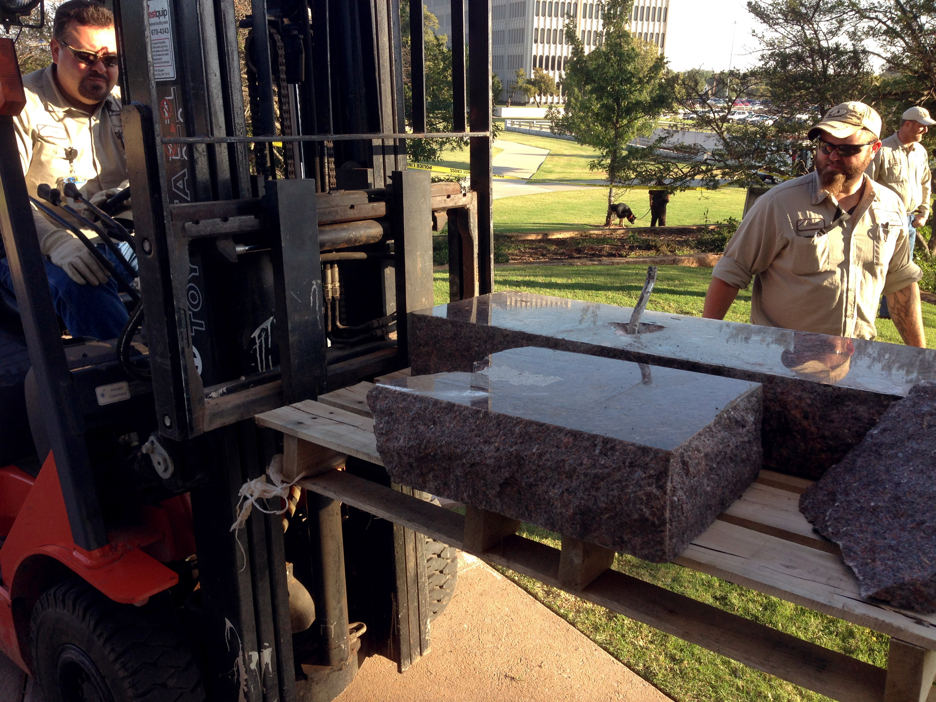 State workers for the Office of Management and Enterprise Services remove the damaged remains of a Ten Commandments monument from the Oklahoma State Capitol grounds on Oct. 24, 2014 in Oklahoma City.