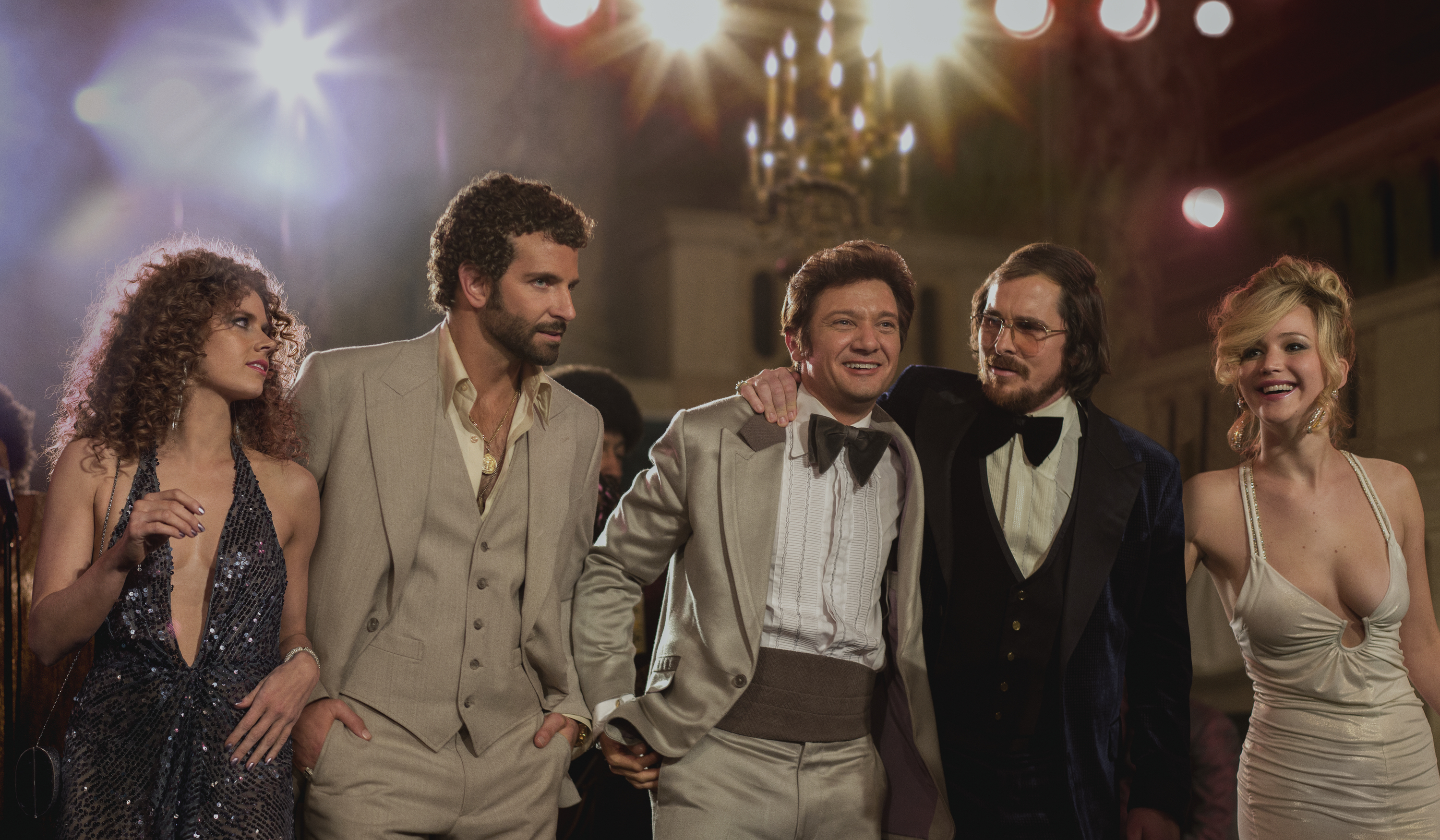 left to right; Amy Adams, as Sydney Prosser, Bradley Cooper, as Richie Dimaso , Jeremy Renner, as Mayor Carmine Polito, Christian Bale as Irving Rosenfeld, and Jennifer Lawrence as Rosalyn Rosenfeld, in a scene from  American Hustle.