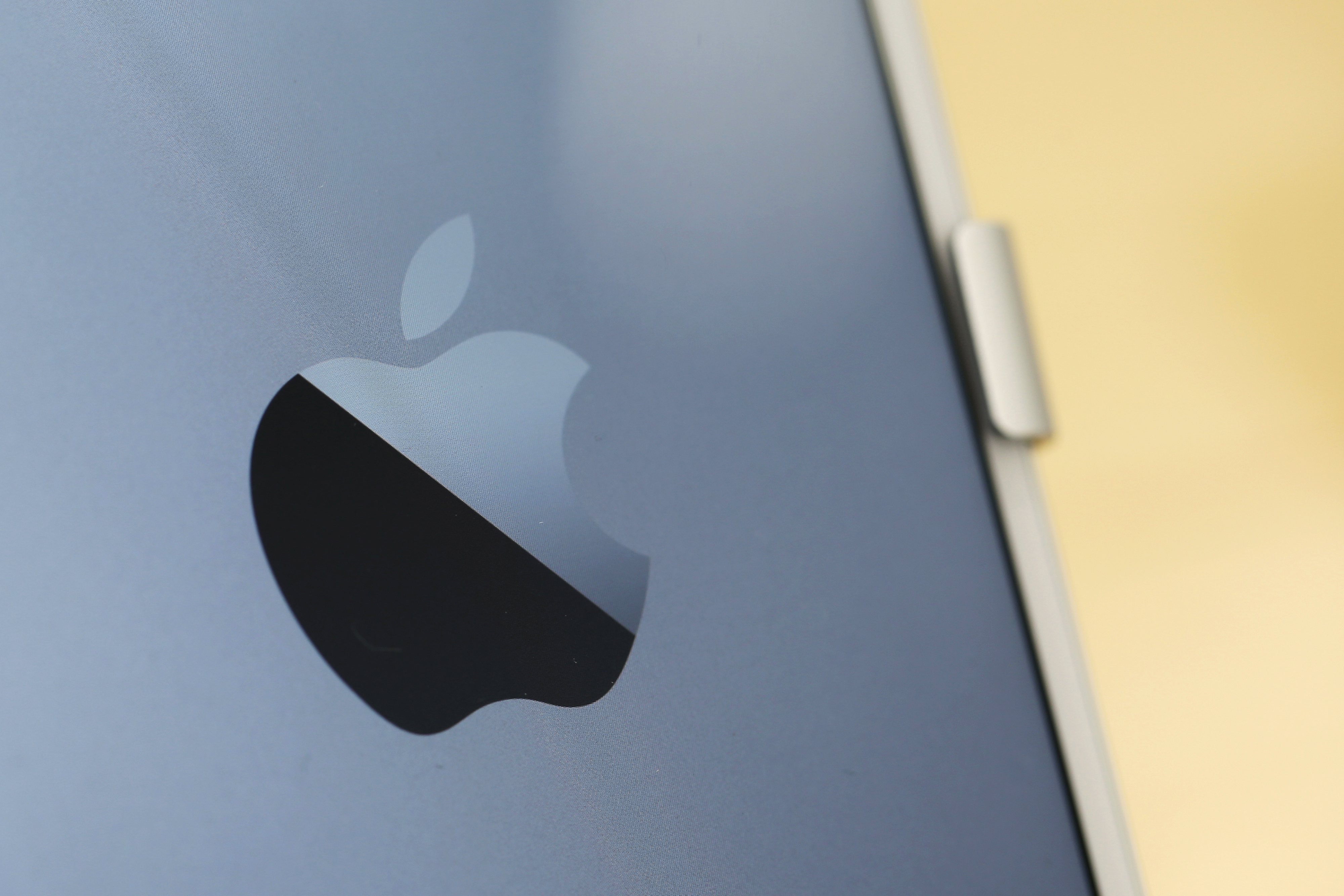 An Apple Inc. logo is displayed on the company's iPhone 6 Plus during the sales launch of the iPhone 6 and iPhone 6 Plus on Sept. 19, 2014.