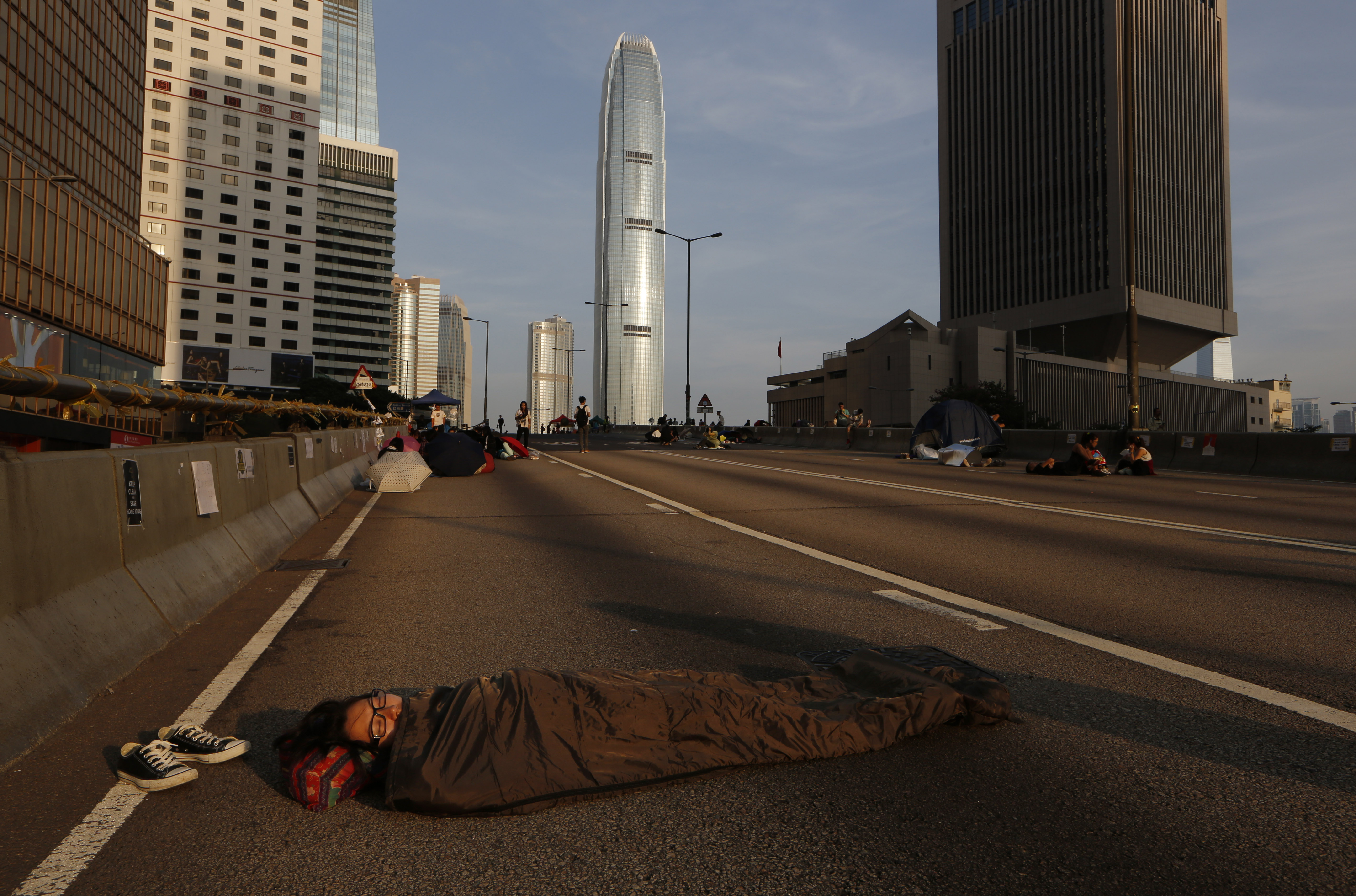 A pro-democracy protester sleeps on a roadside in the occupied areas near the government headquarters in Hong Kong on Oct. 6, 2014