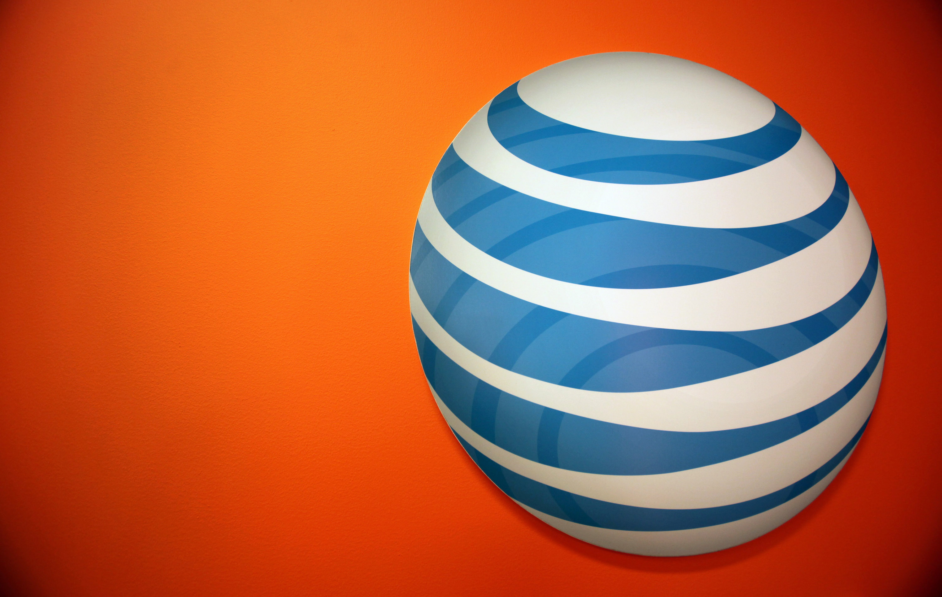 The AT&T Inc. logo is displayed at the company's new store in Chicago, Illinois, U.S., on Friday, Sept. 30, 2011.