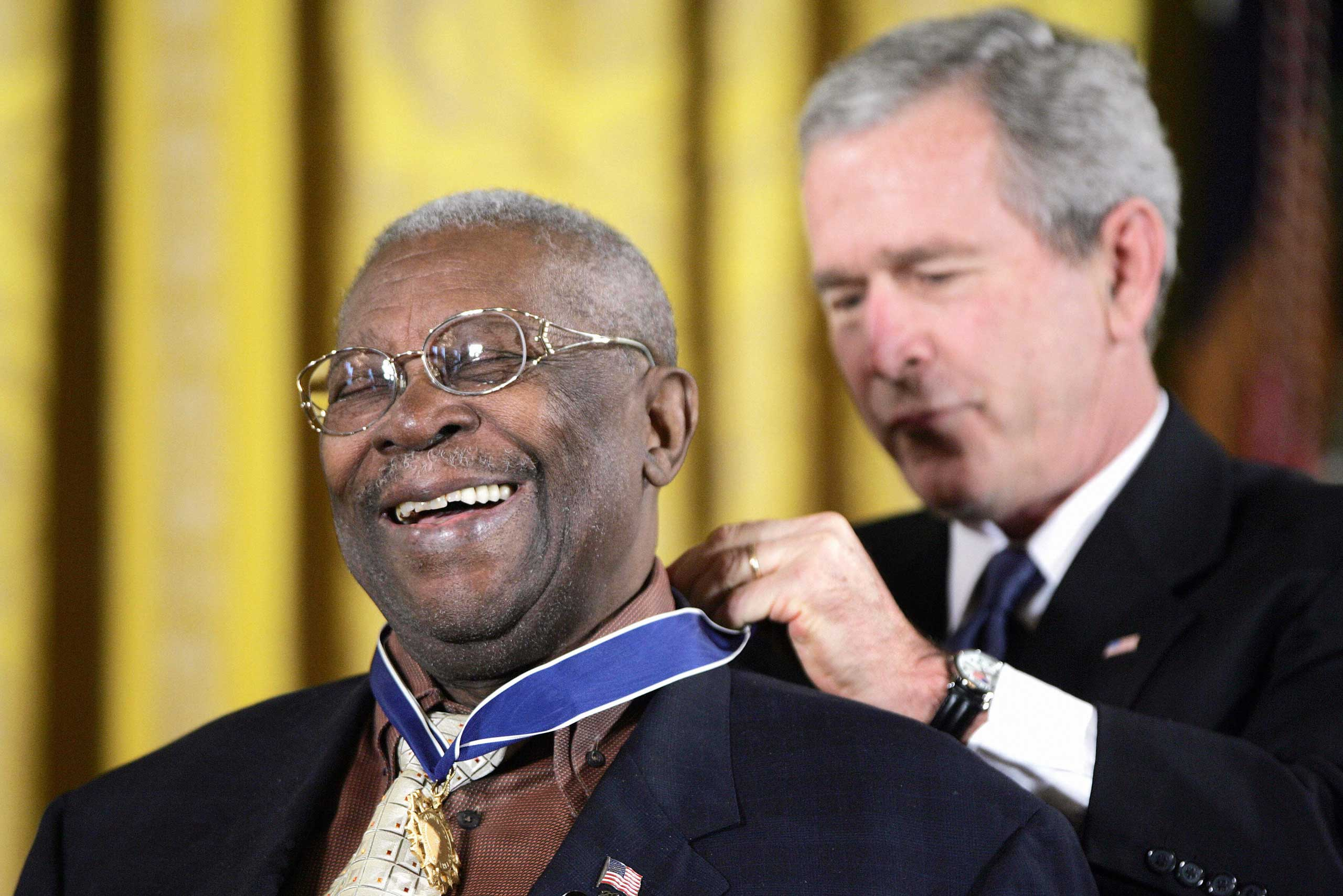 B.B. King smiles while President George W. Bush presents King with the Medal of Freedom on Dec. 15, 2006 in the East Room of the White House in Washington, DC.