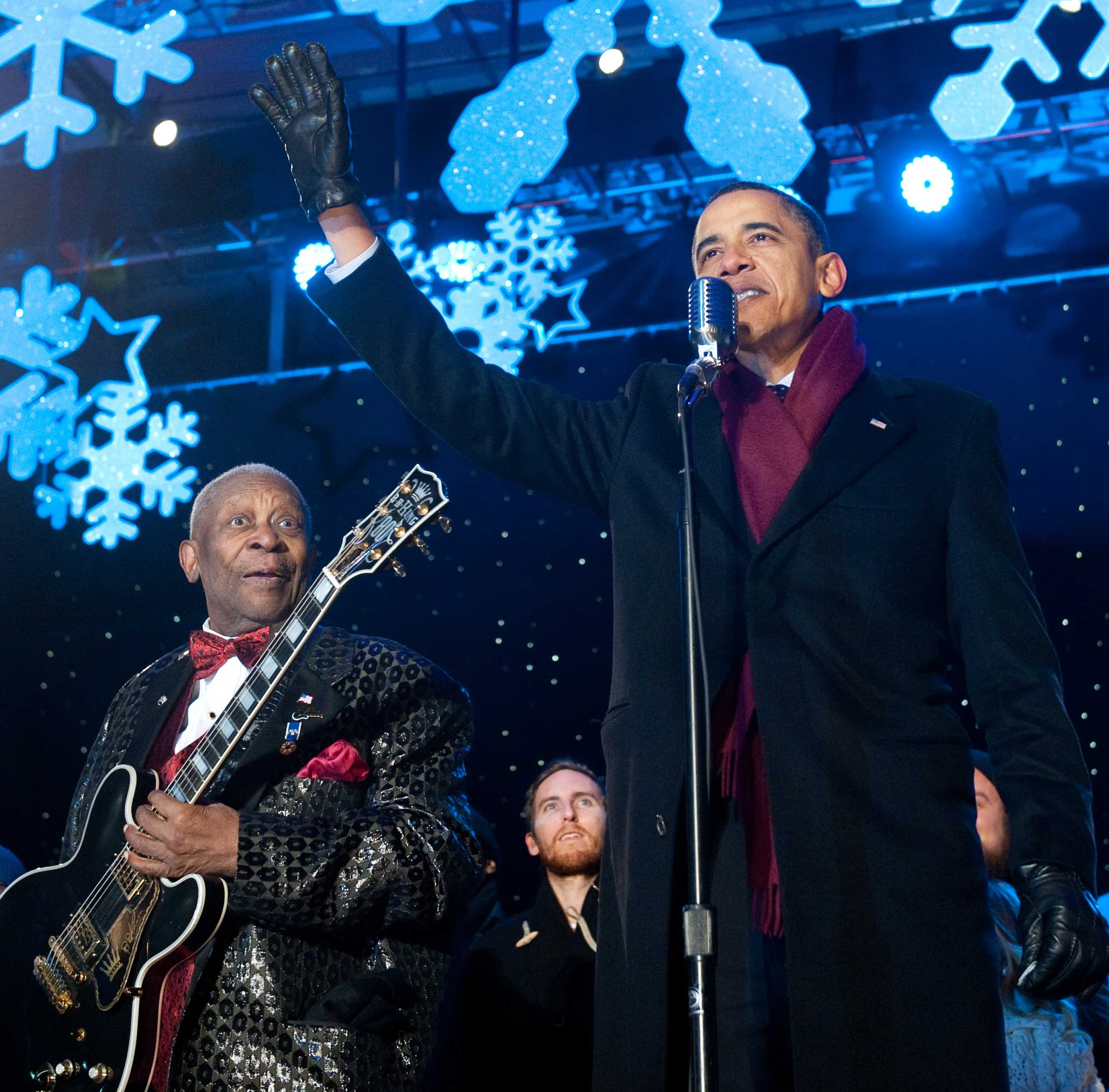 From Left: B.B. King watches as President Barack Obama waves during the National Christmas Tree Lighting ceremony on the Ellipse near the White House in Washington, D.C. on Dec. 9, 2010.