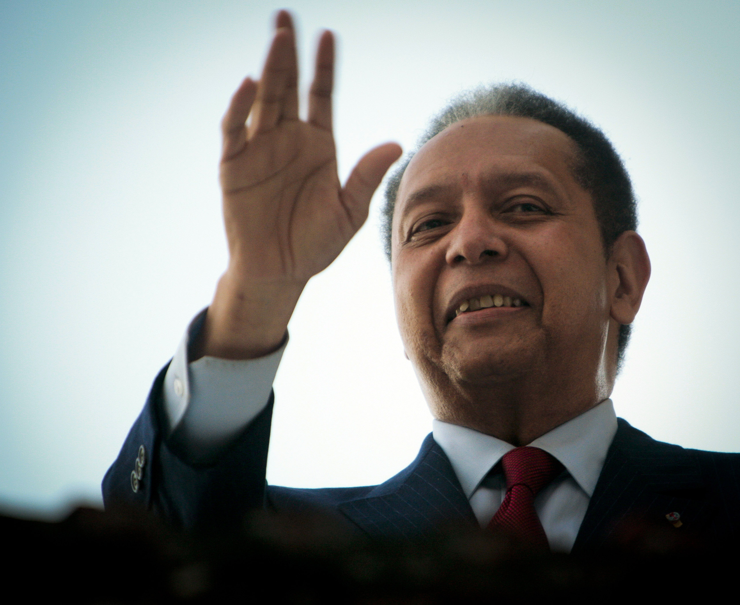 Former leader of Haiti Jean-Claude  Baby Doc  Duvalier waves from a balcony following a press conference at his house in Petionville January 21, 2011 in Port-au-Prince, Haiti.