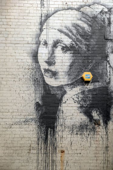 New Banksy 'earring' mural appears in Bristol Harbourside