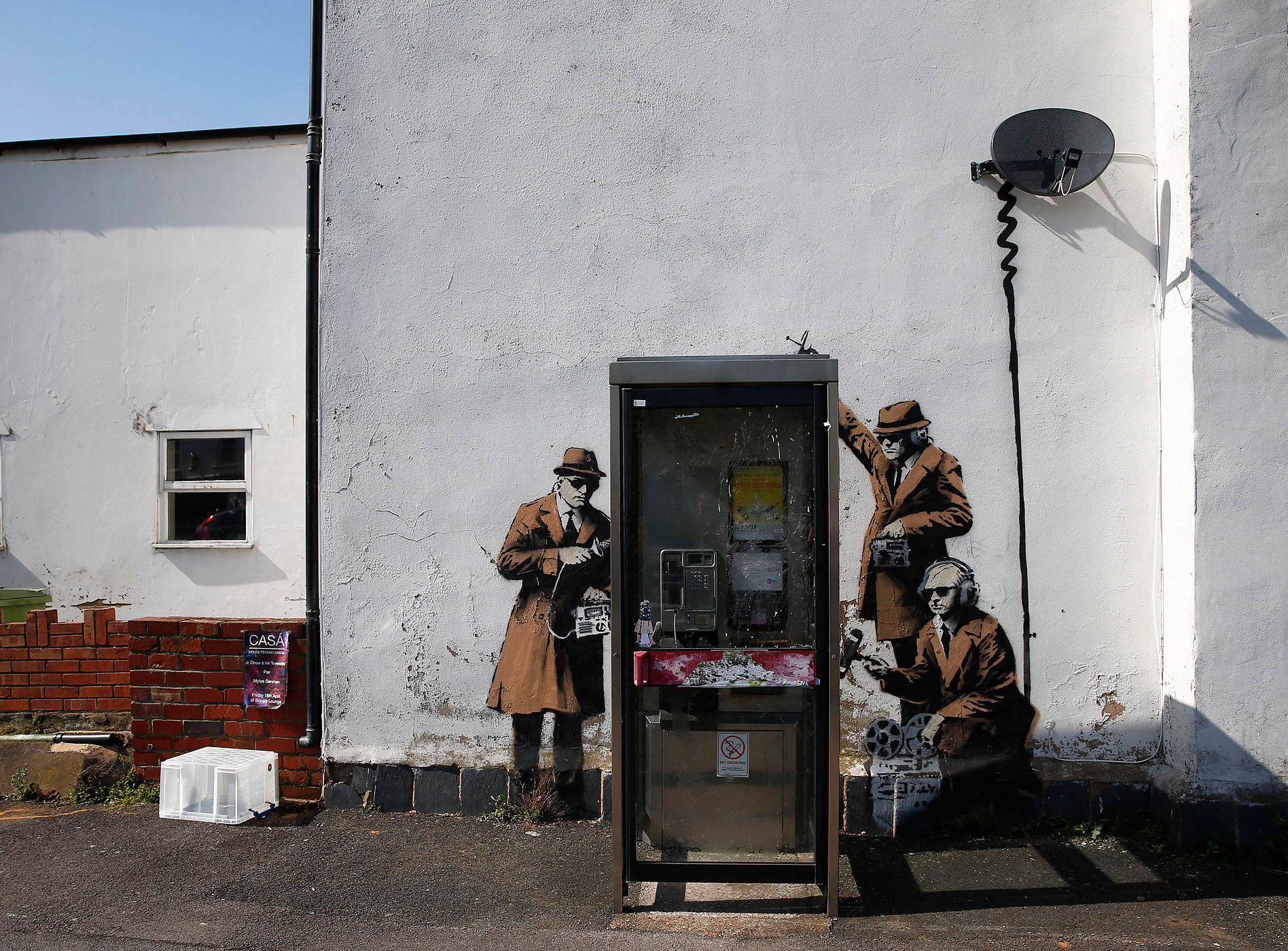 A Banksy is seen near the headquarters of Britain's eavesdropping agency, Government Communications Headquarters, known as GCHQ, in Cheltenham, England on April 16, 2014.