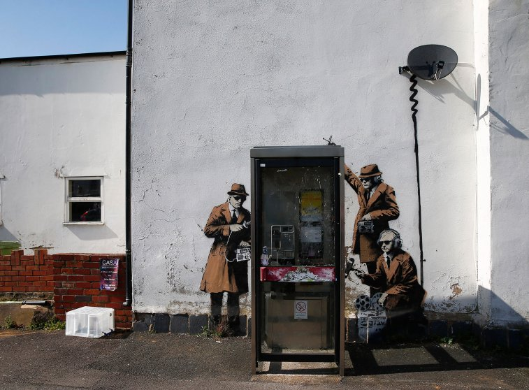 Graffiti art is seen on a wall near the headquarters of Britain's eavesdropping agency, GCHQ, in Cheltenham, western England