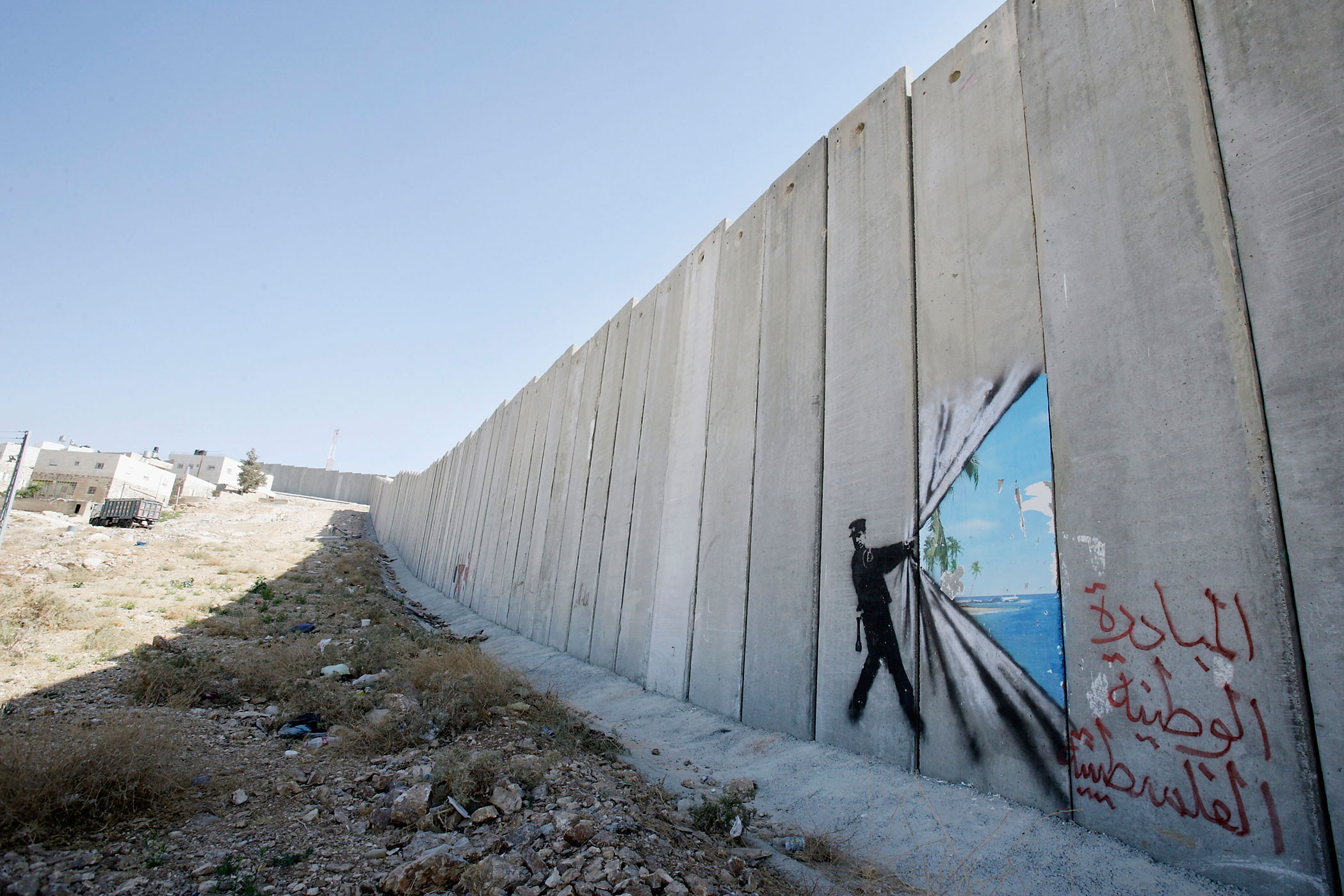 A Banksy is seen on Israel's highly controversial West Bank barrier in Abu Dis on August 6, 2005.