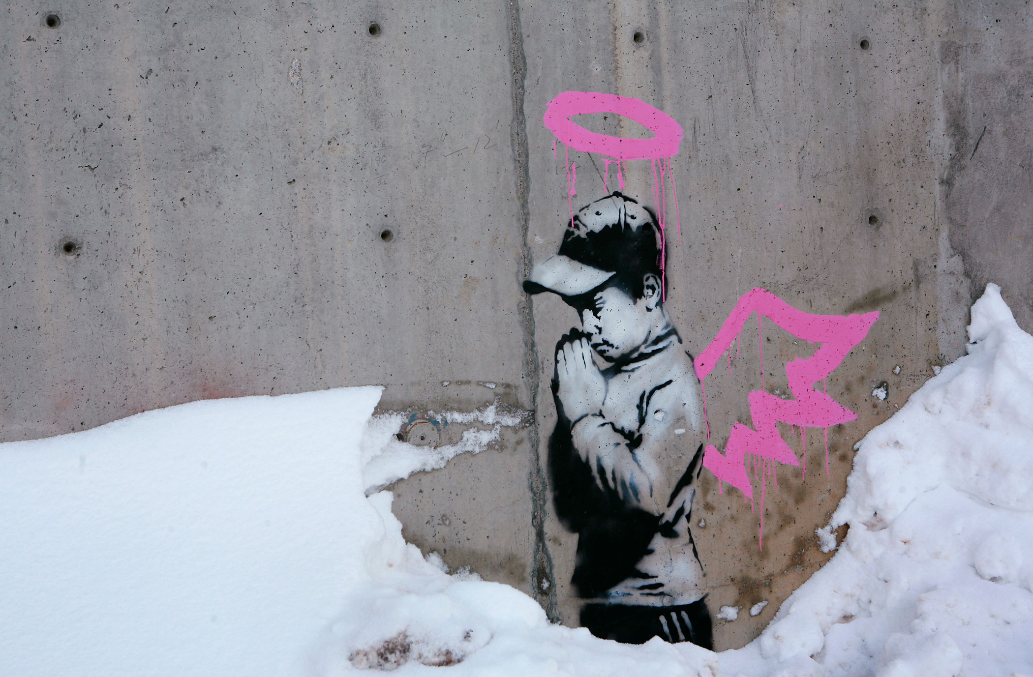Artwork by Banksy is seen on a wall during the Sundance Film Festival in Park City, Utah, January 22, 2010.