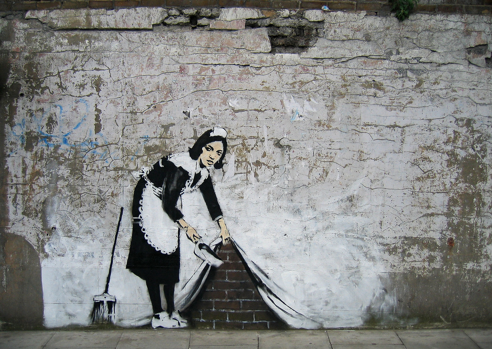 Banksy's 'Sweeping It Under The Carpet' is seen in London, England on May 16, 2006.