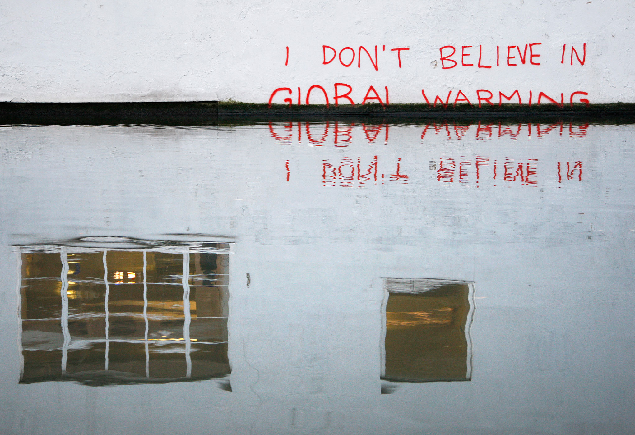 A Banksy is seen on a wall next to the Regent's Canal, in Camden in London on December 22, 2009.