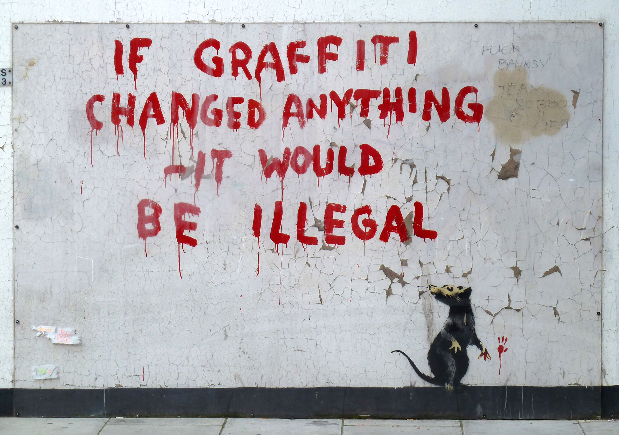A Banksy appears in the neighborhood of Fitzrovia in London, England on October 6, 2011.