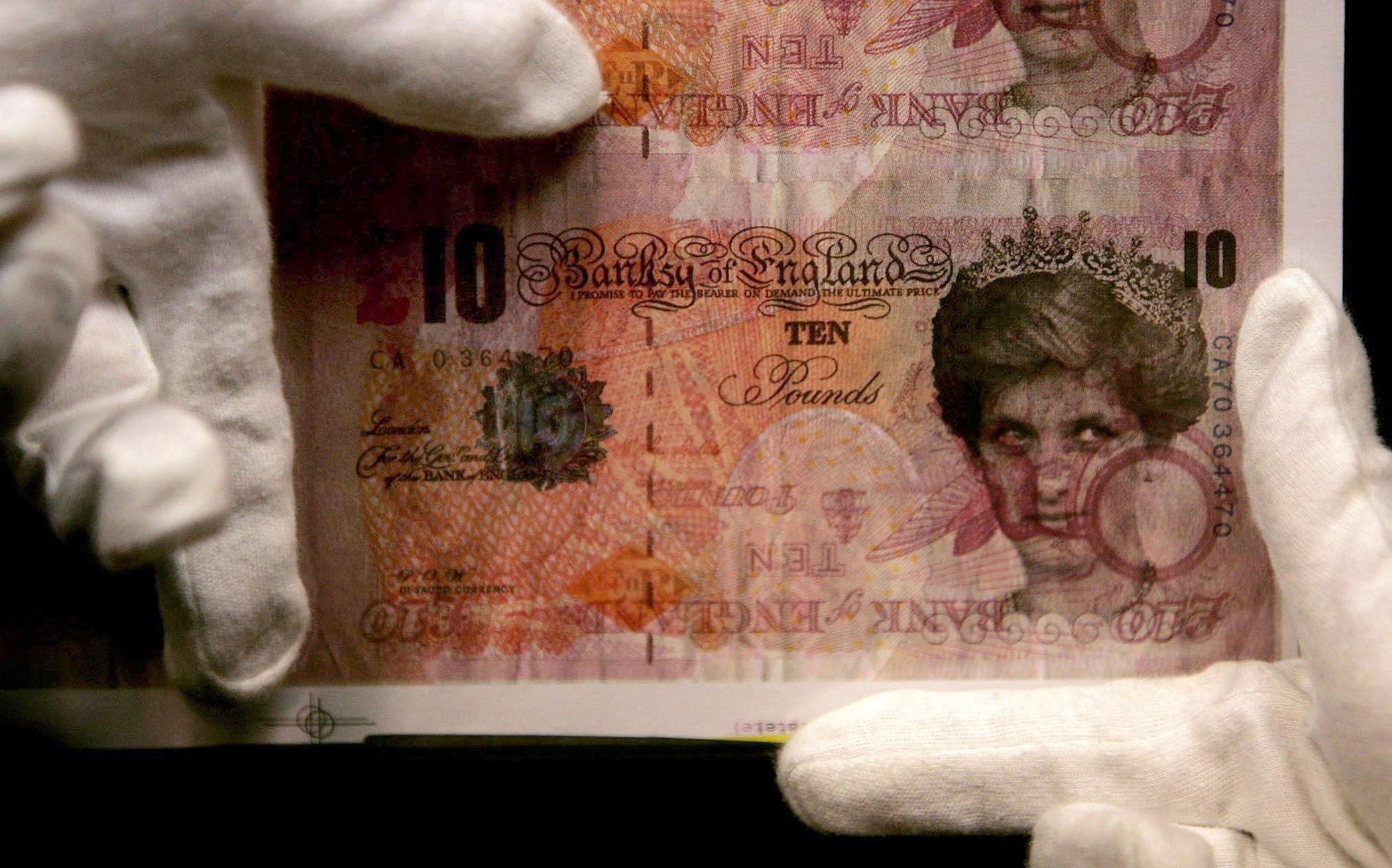 A screen print titled 'Di Faced Tenners' showing the face of Princess Diana in place of Britain's Queen Elizabeth II is one of ten Banksy pieces on display in Bonhams Auction House in London on Monday, Oct. 22, 2007