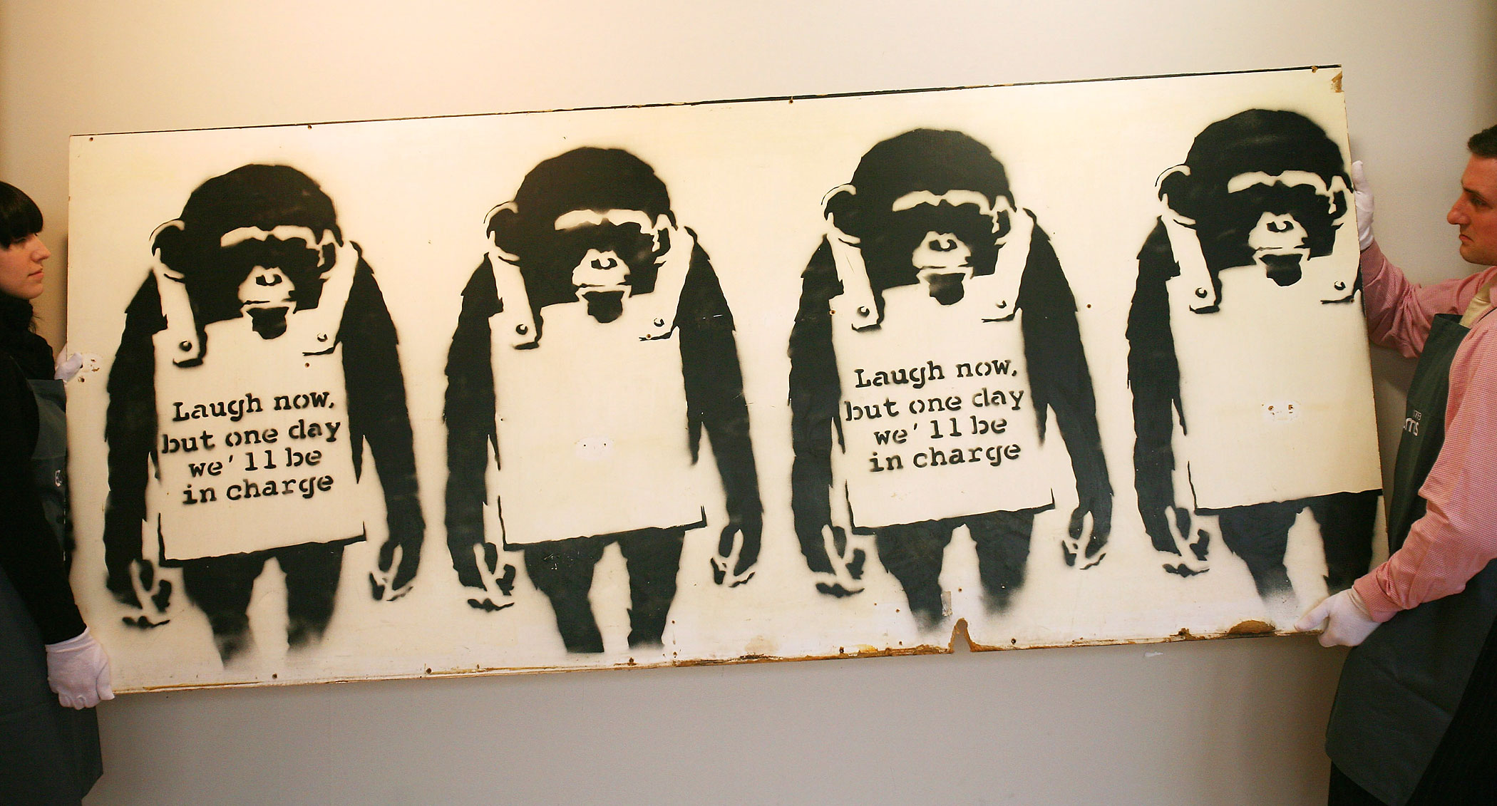 Banksy's Laugh Now is held by a Bonham's employee's during a viewing for the World's First Urban Art Auction at Bonham's on January 22, 2008 in London, England.