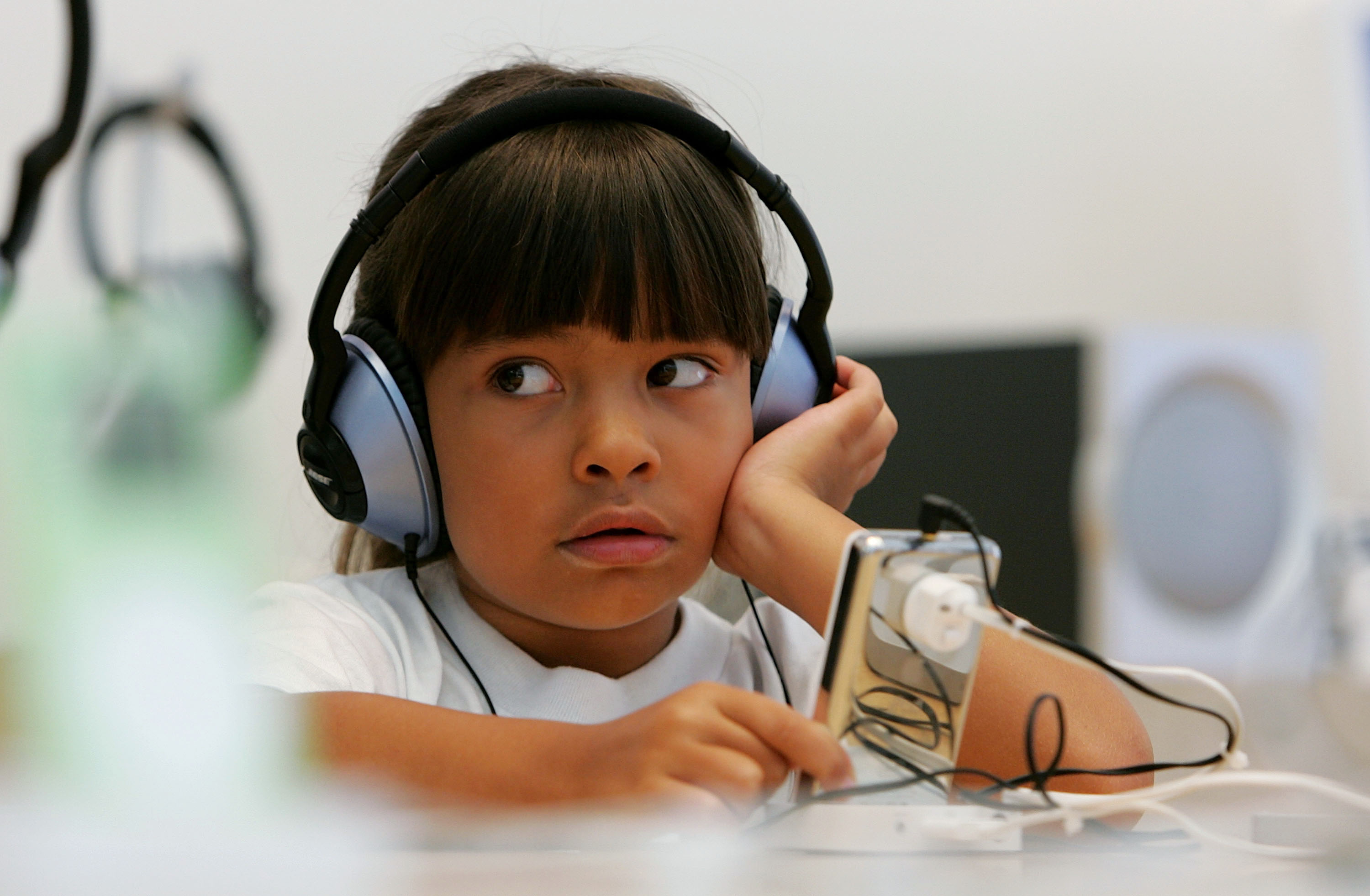 Six-year-old Emma Cordell listens to a new iPod on display at the Apple Store July 14, 2005 in San Francisco, California.