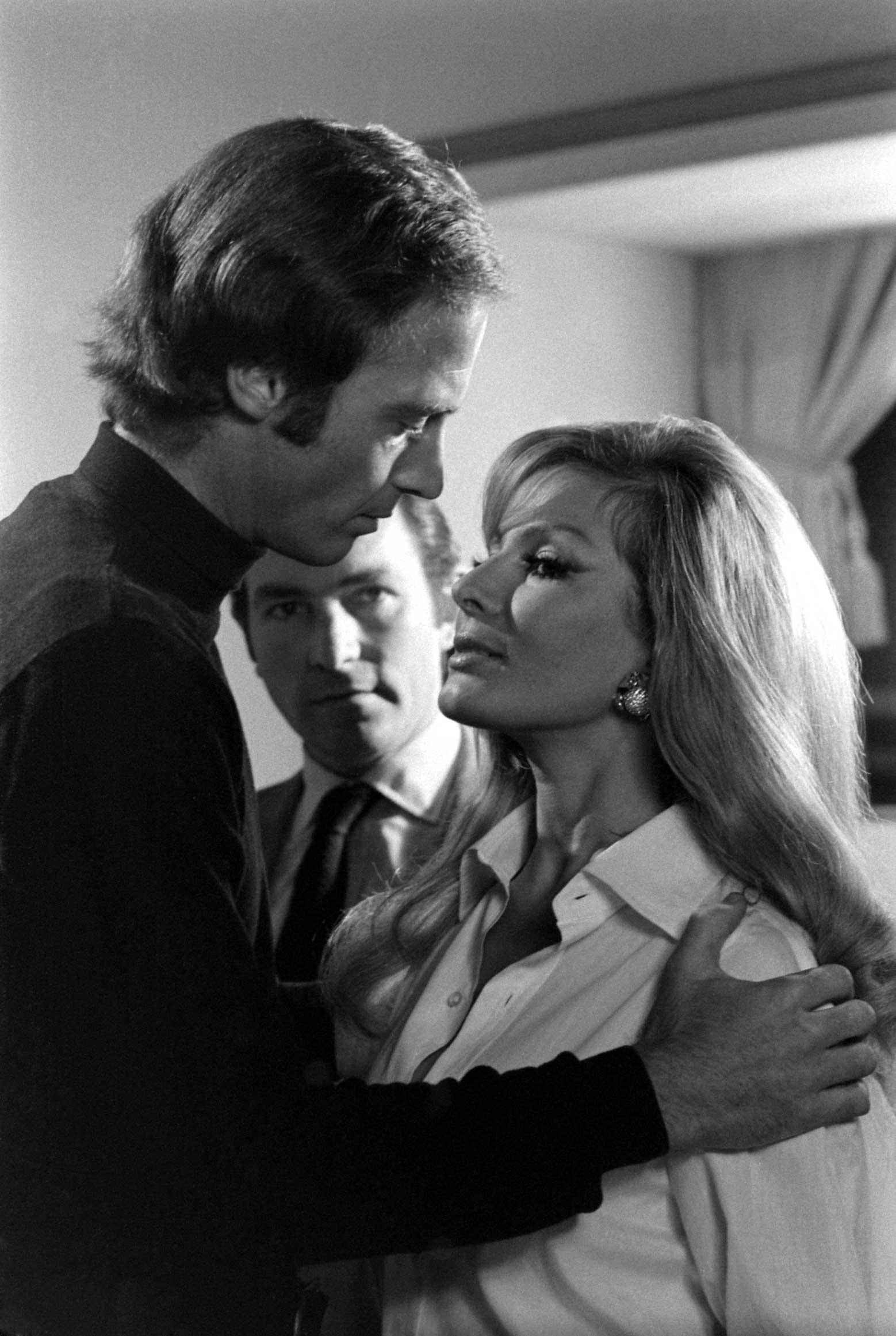 Director Peter Hunt studies John Richardson during his audition, 1967.