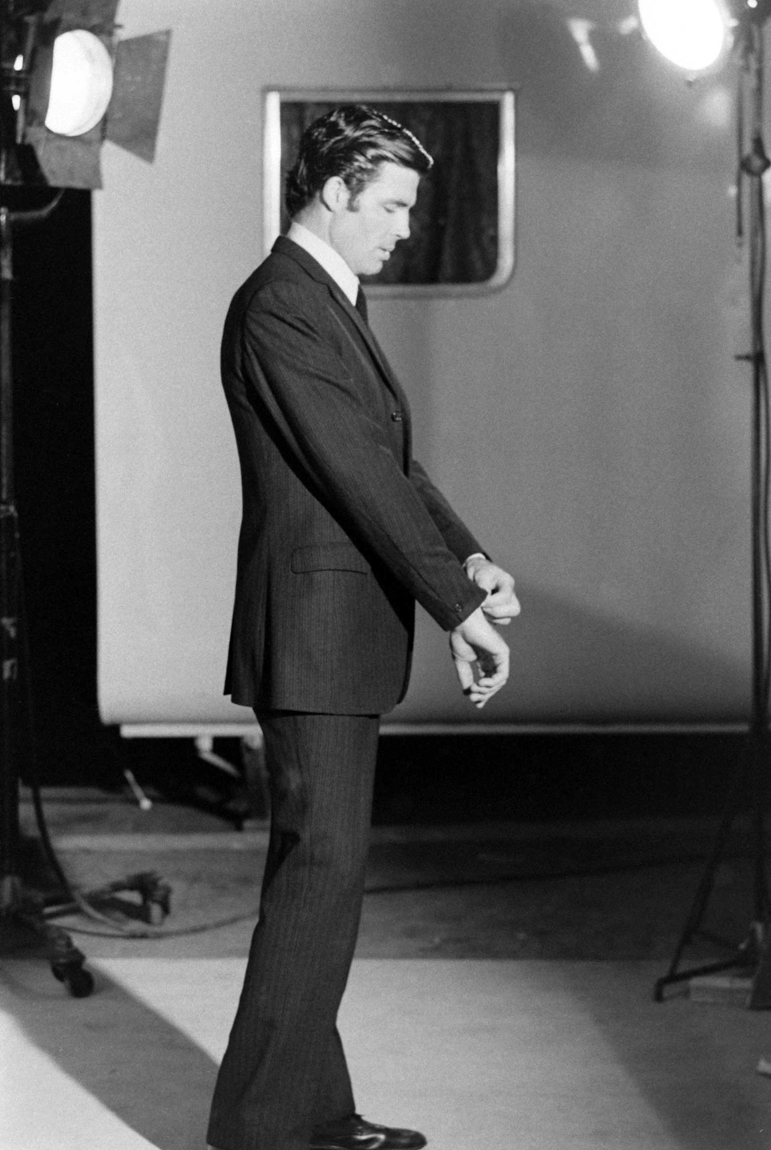 James Bond hopeful Robert Campbell adjusts his shirt and jacket, 1967.