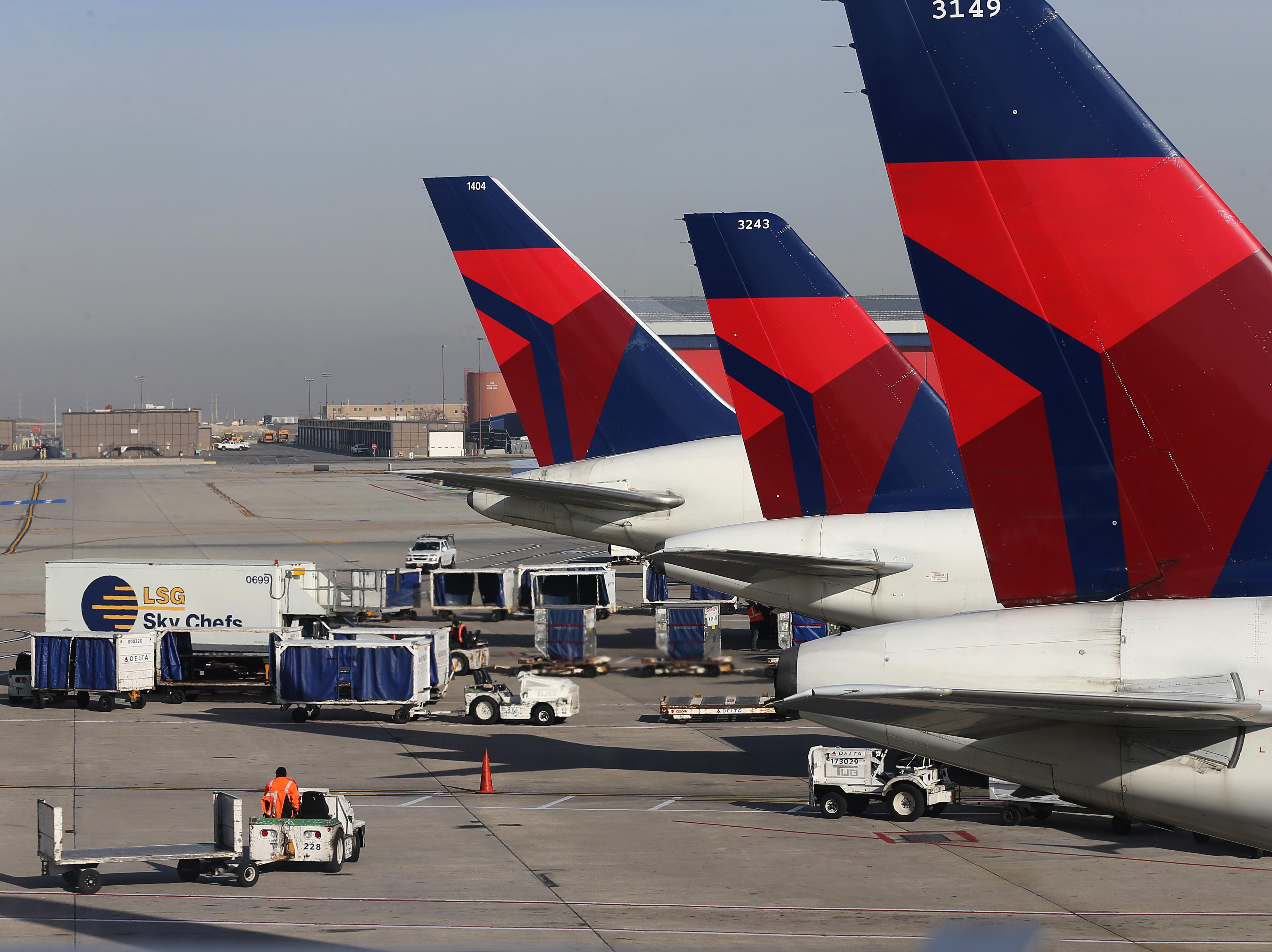 Delta planes at the Salt Lake City international Airport on November 27, 2013 in Salt Lake City, Utah.