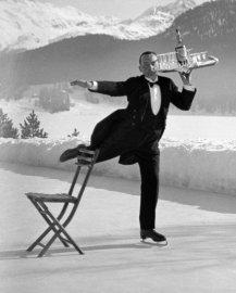 Skating waiter Ren� Breguet delivers drinks at the Grand Hotel, St. Moritz, 1932.